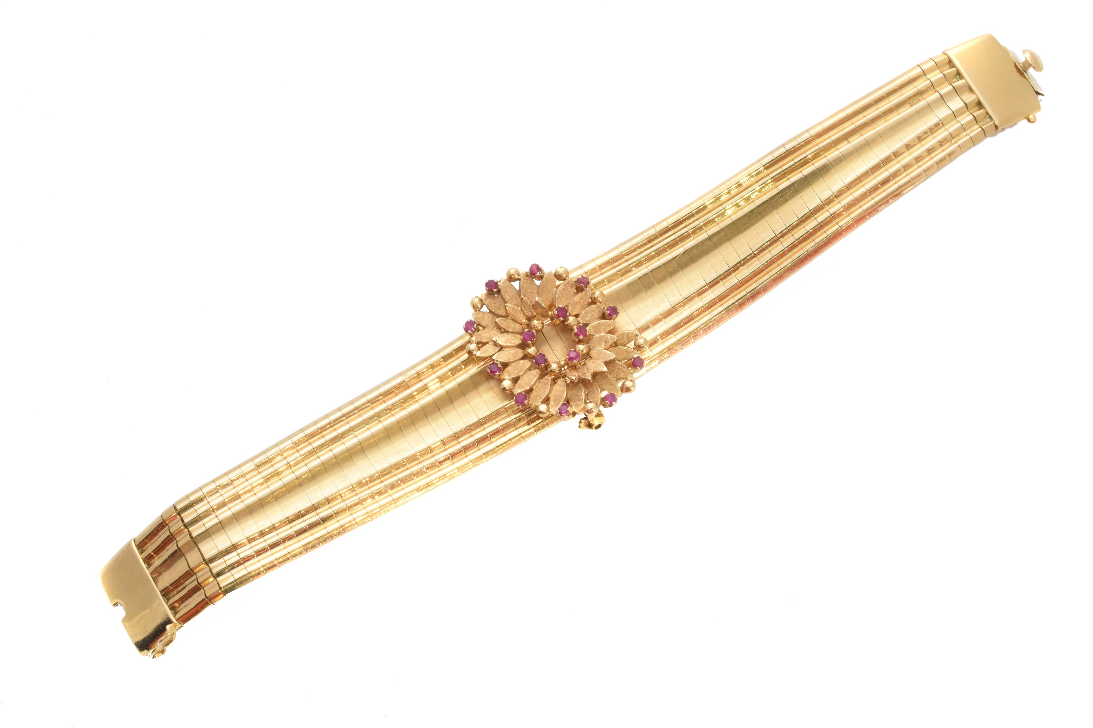 An 18ct gold ruby bracelet, the tapered and grooved fancy link bracelet, with detachable circular shape ruby foliate cluster, cluster may also be worn as a brooch, stamped FCT 750, length 20cm, gross weight 77.3g.