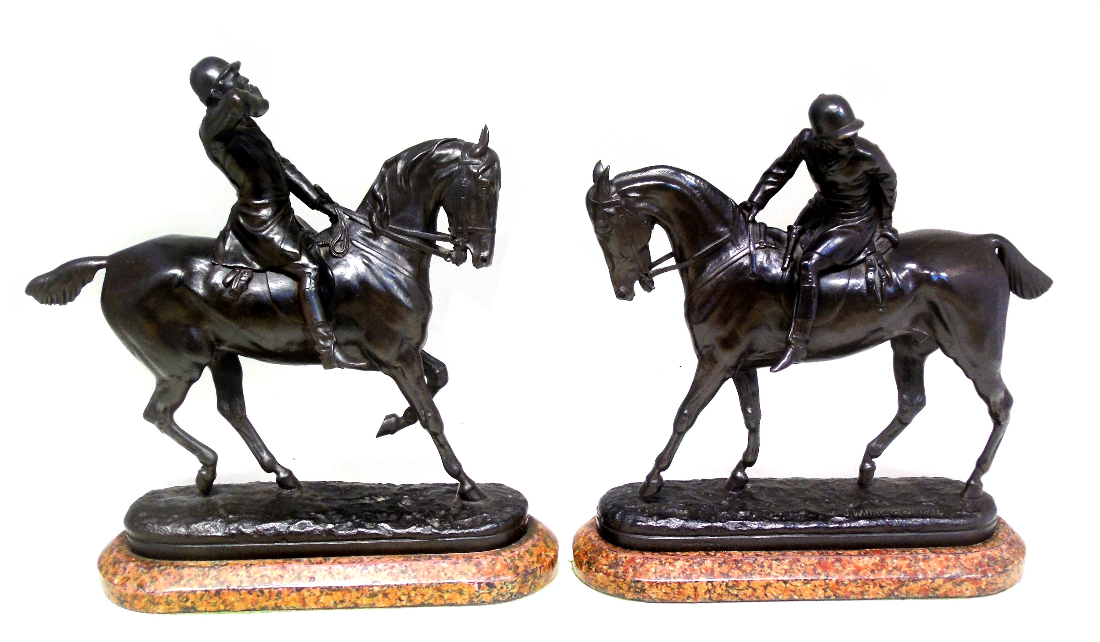 "Pair of bronze figures of huntsmen, each cast in the form of a figure sitting on a horse, one hollering, the other listening, oval bases signed J. Willisgood, 1874, height 28cm (11""), each bronze supported on pink granite plinths."