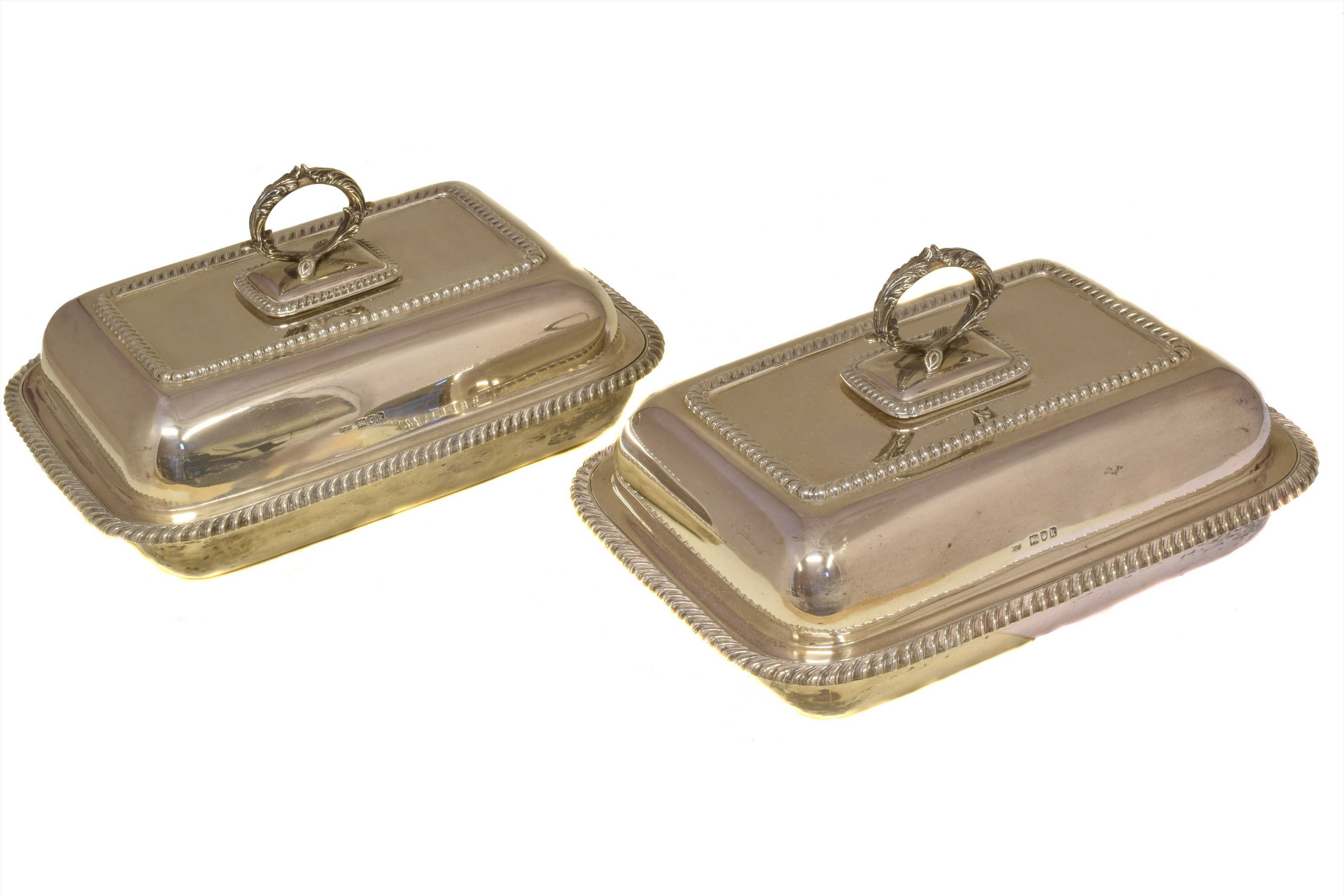 A pair of Edward VII silver tureens, of rectangular form with gadrooned rim and foliate handle, hallmarks for Hawksworth, Eyre & Co Ltd., London, 1905, dimensions 30.5 x 22.8 x 12.5cm, gross weight 113.4ozt.