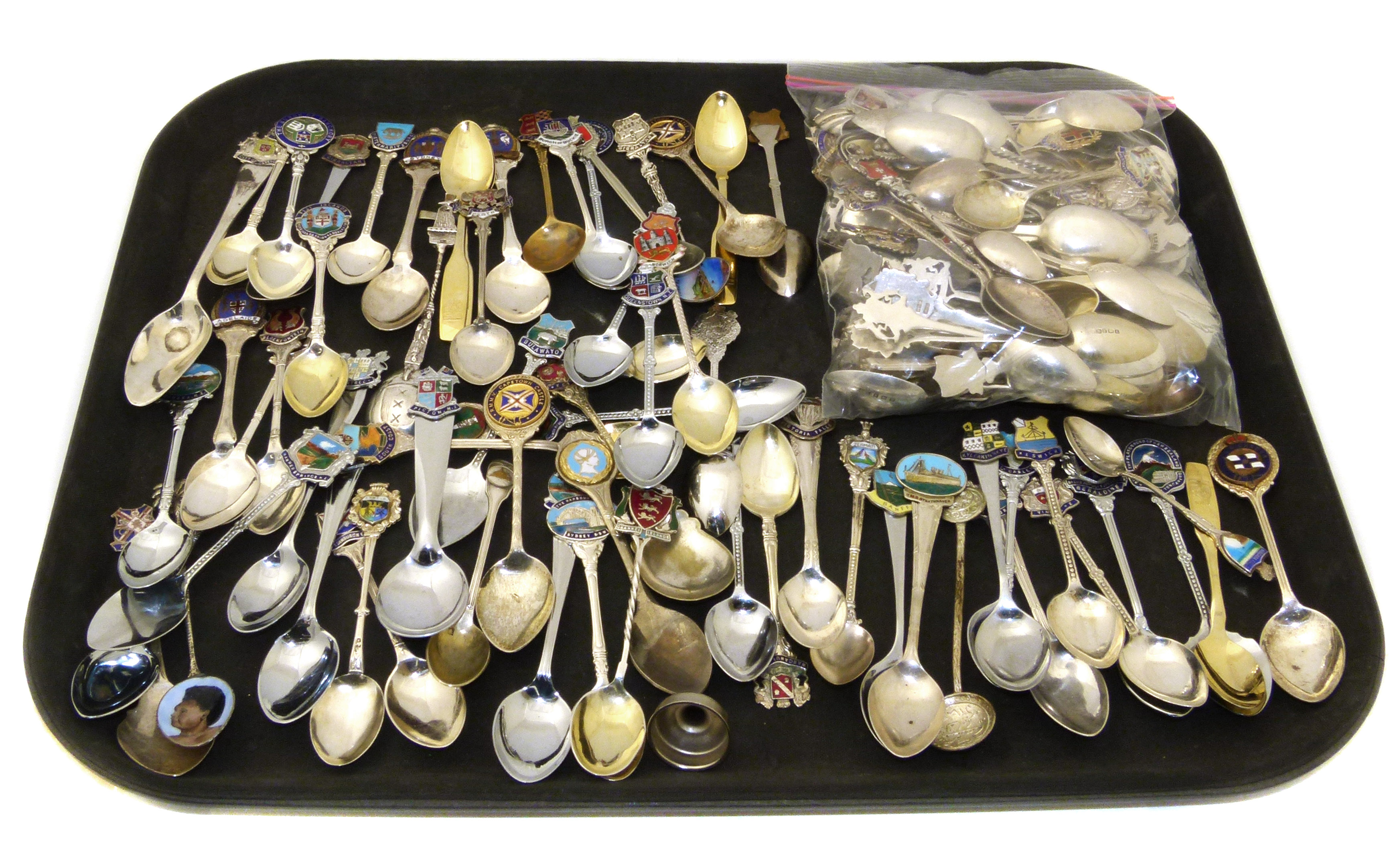 A large collection of silver and EPNS souvenir spoons,
