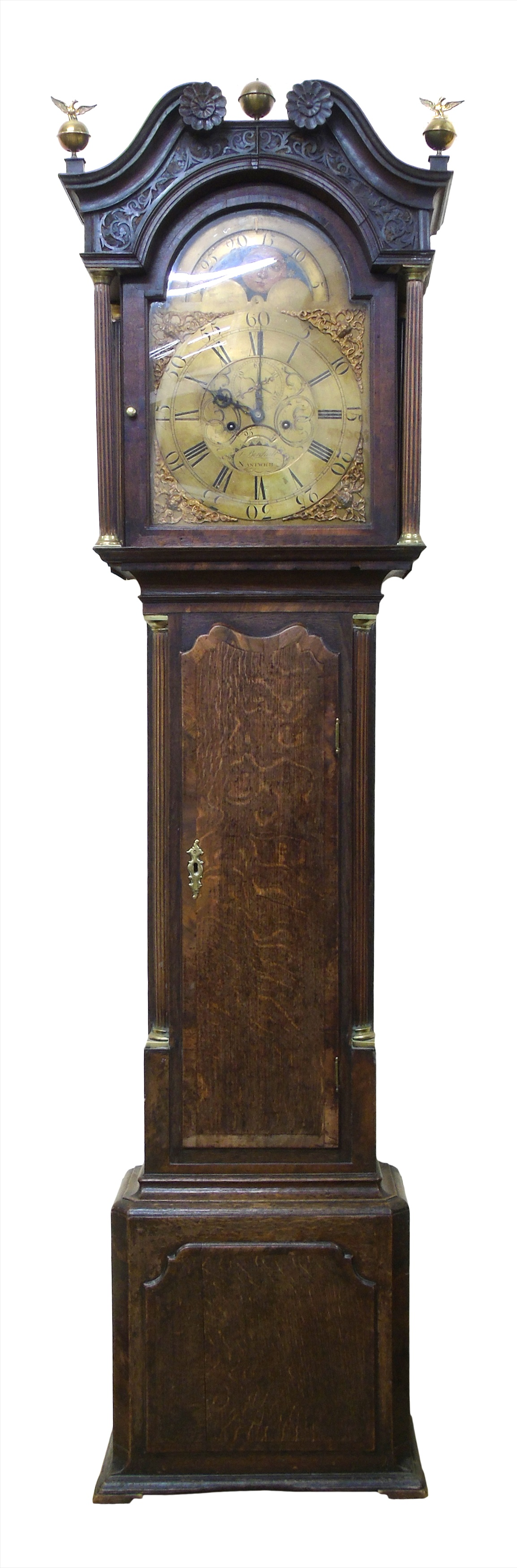 "Longcase clock by Thomas Birchall, Nantwich, 8-day movement, striking on single bell, brass arched dial with rolling moon, secondary minute dial and date aperture, cast metal spandrels, case with canopy, swan neck pediment with blind fretwork, trunk with quartered columns, long walnut cross-banded door, box base with single panel, height 210cm (83"")."