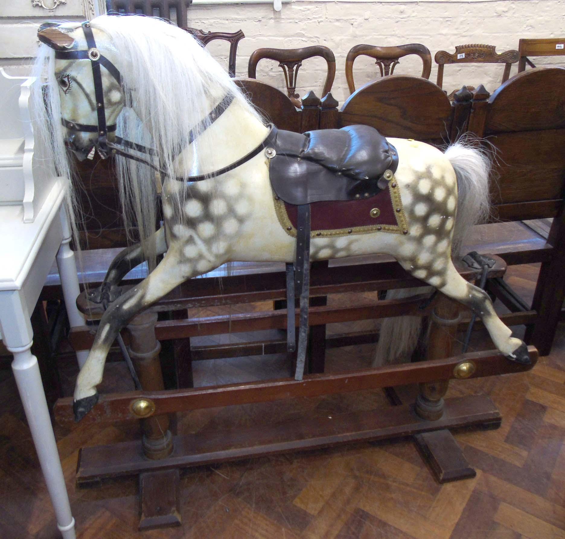 A dapple grey rocking horse