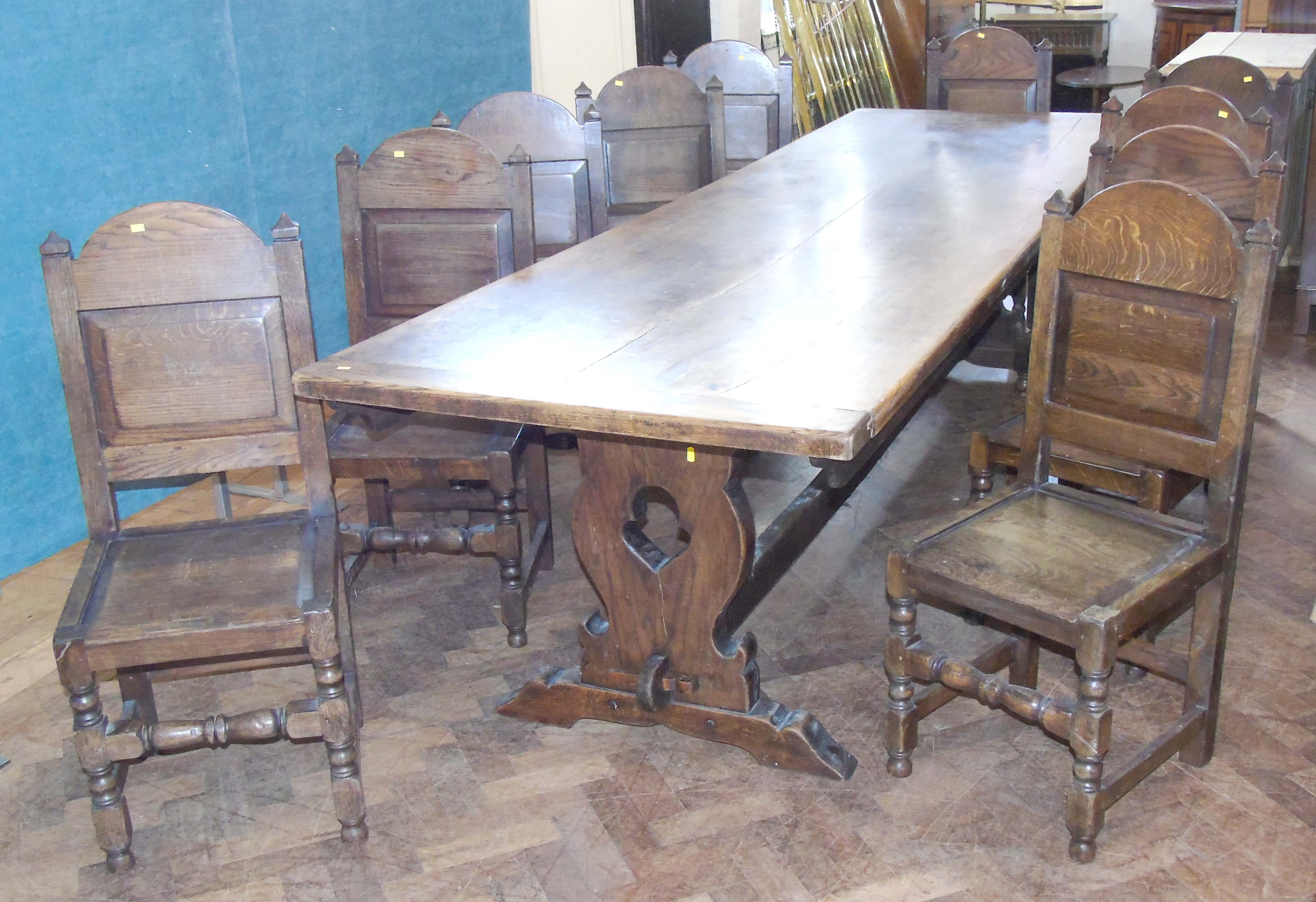Large oak refectory table and ten 18th century style oak chairs.