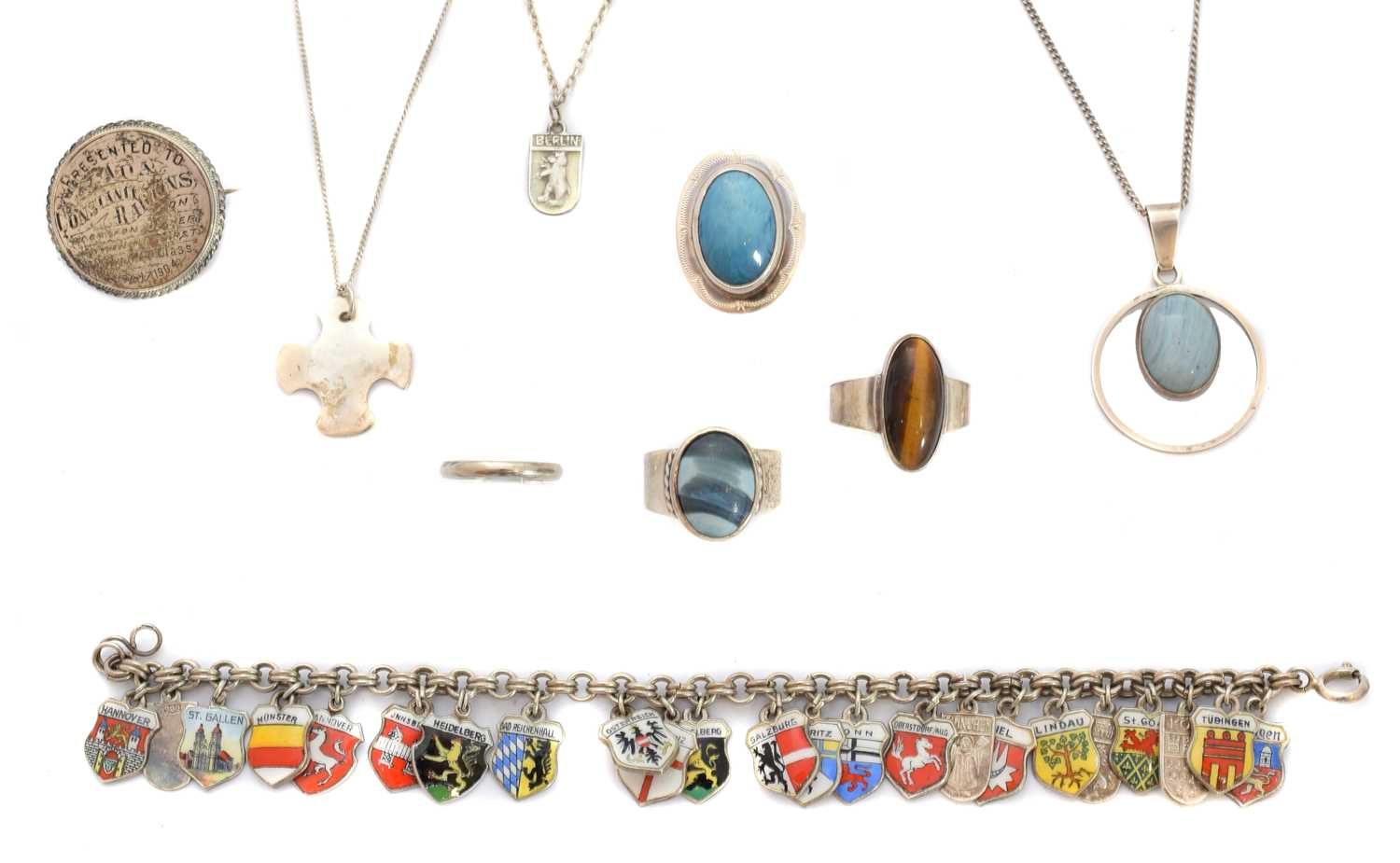 A selection of Swedish & other silver jewellery, to include two Swedish rings, a Swedish pendant on chain, together with a tiger's eye ring, an enamel crest bracelet, a silver pendant, etc.