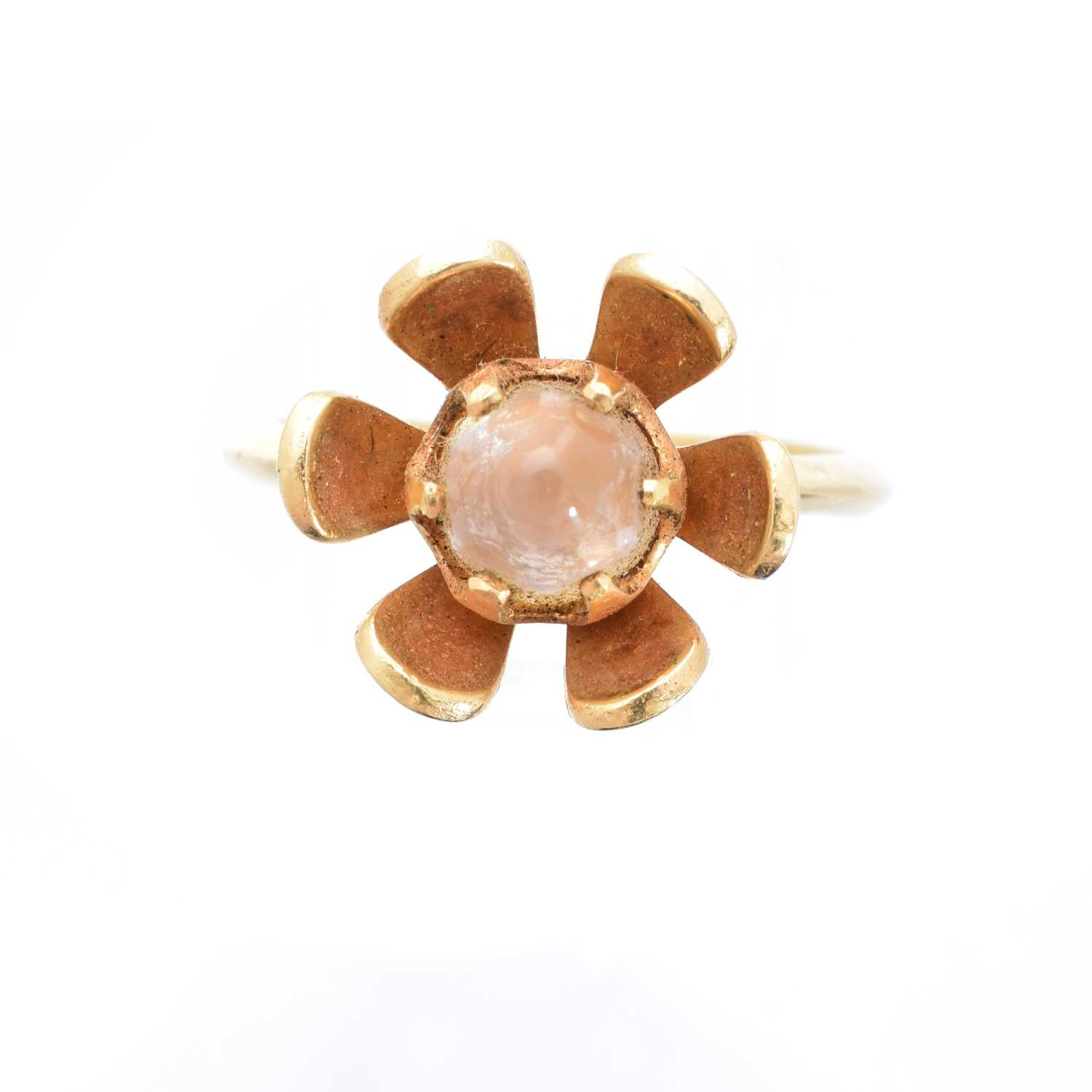 A 15ct gold moonstone dress ring, the moonstone cabochon within a floral surround, stamped N.J. Ltd, import marks for Birmingham, 1967, ring size L1/2, gross weight 4.4g.