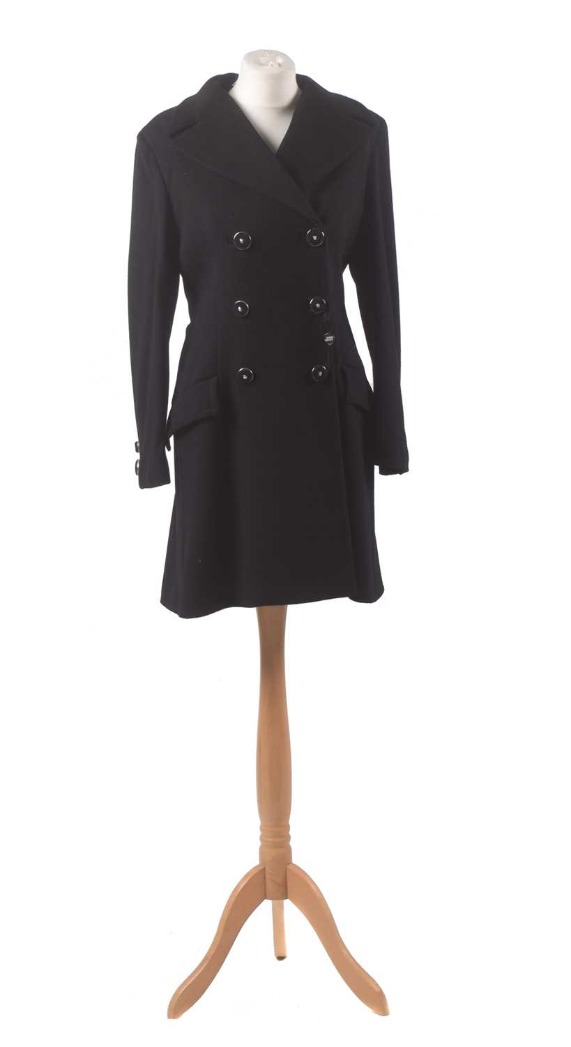 A black wool coat by Gianni Versace Couture, the mid length black wool coat with silver tone buttons bearing makers logo, size 42.