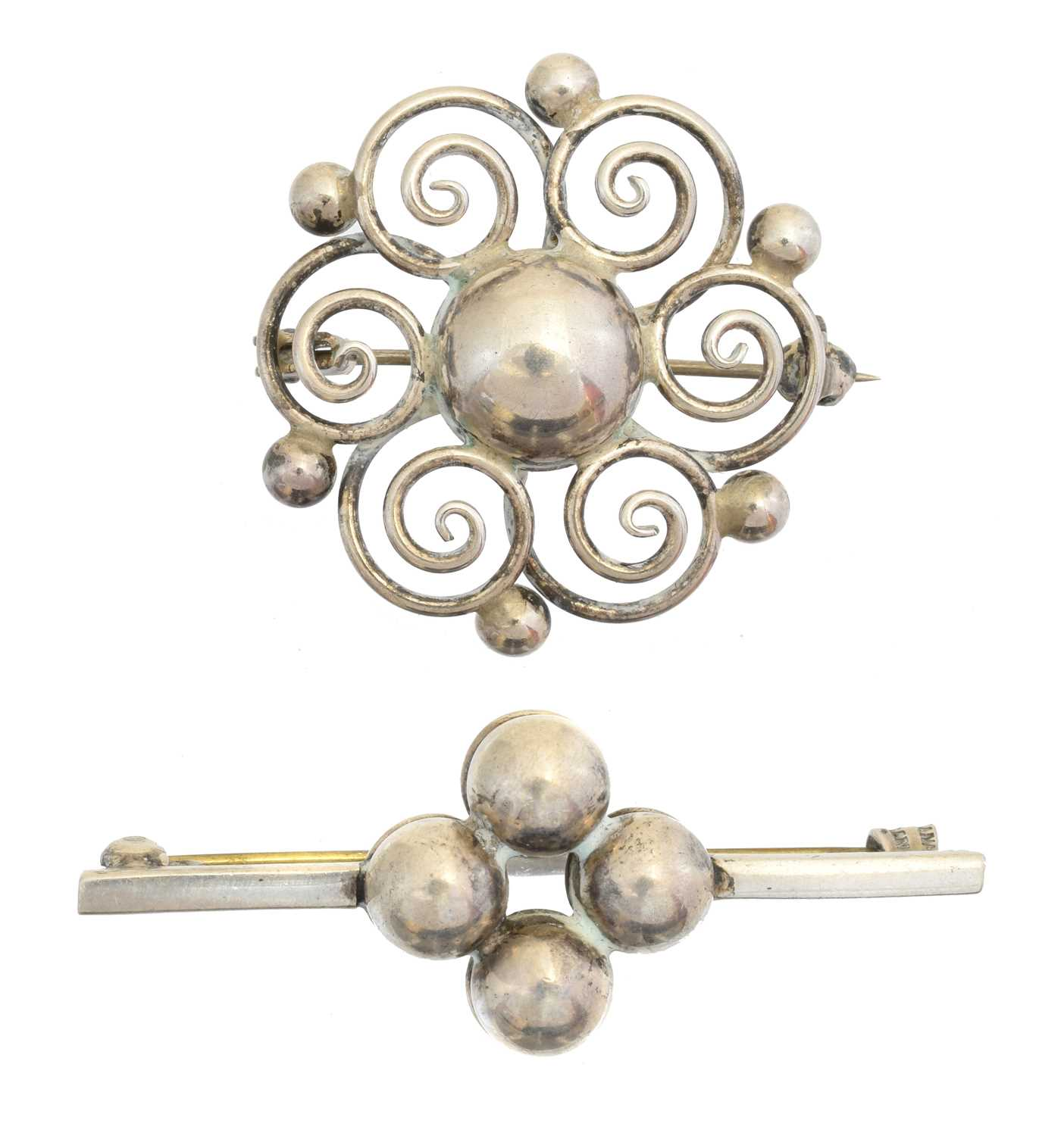 Two Danish silver brooches, the first by Hermann Siersbol, with scrolling design, the second by Sanino with polished quatrefoil design, each with maker's marks, stamped Denmark,
