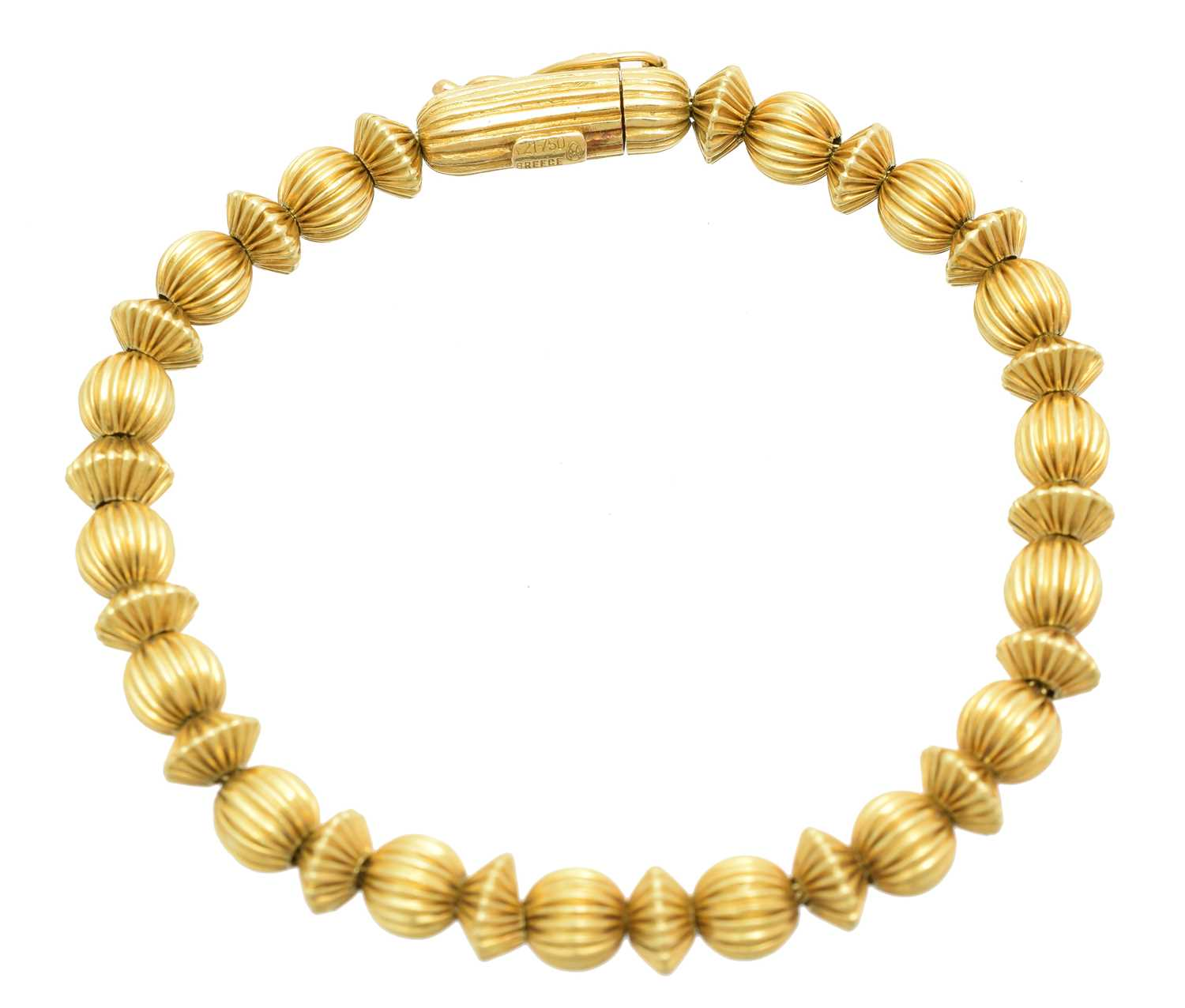 A bracelet by Ilias Lalaounis, designed as a series of grooved beads with a cylindrical push piece clasp, maker's marks for Ilias Lalaounis, stamped A21-750, length 19cm, gross weight 16.4g.