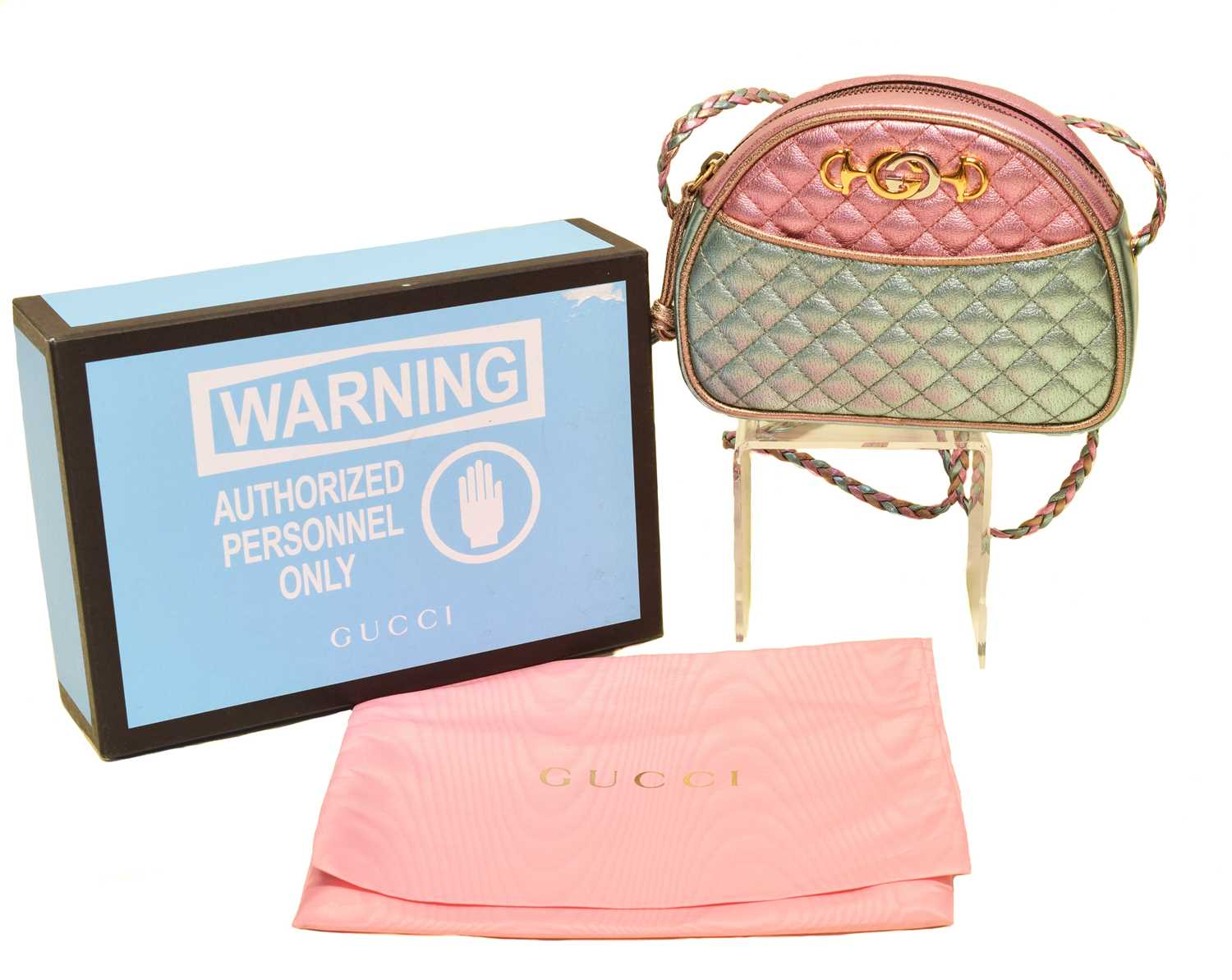 A Gucci Trapuntata Crossbody Mini Bag, the metallic pink, blue and gold laminated quilted calf leather exterior, with interlaced leather shoulder straps, and gold and silver tone hardware, serial no. 534951-534563. With maker's detachable keyring, booklet, box and dustbag.
