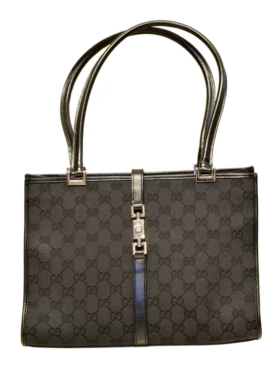 A Gucci Square Jackie Bag, the black monogrammed canvas exterior with black leather strap and ruthenium hardware, serial no. 002/1073/002214.