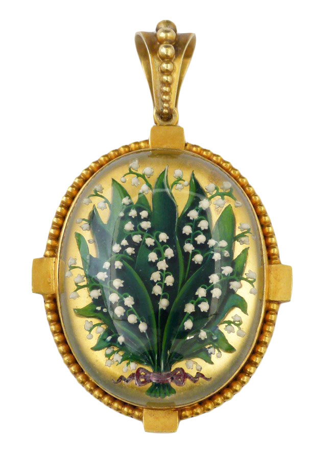 A late Victorian Essex Crystal locket, the oval reverse carved intaglio depicting a lily of the valley with red ribbon accent, within a beaded frame, tapered surmount and locket reverse, length 3.5cm.