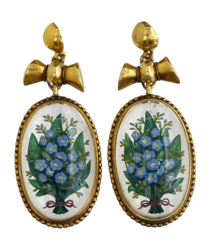 A pair of late Victorian Essex Crystal earrings, each designed as an oval reverse carved intaglio depicting forget-me-nots with red ribbon accent, within a beaded border and bow surmount, length 3.5cm.