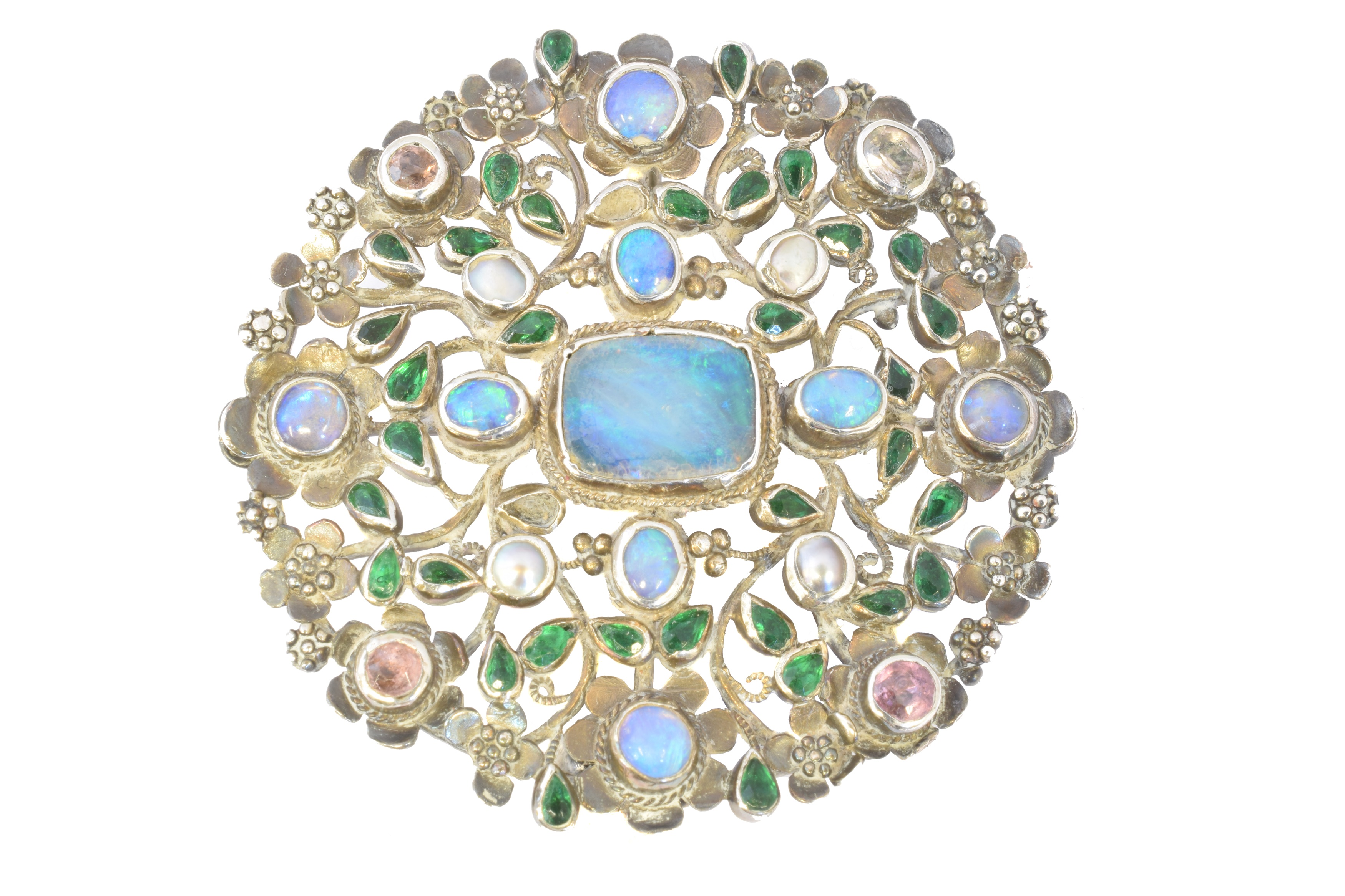 An Arts & Crafts opal and vari gem brooch attributed to Arthur and Georgie Gaskin