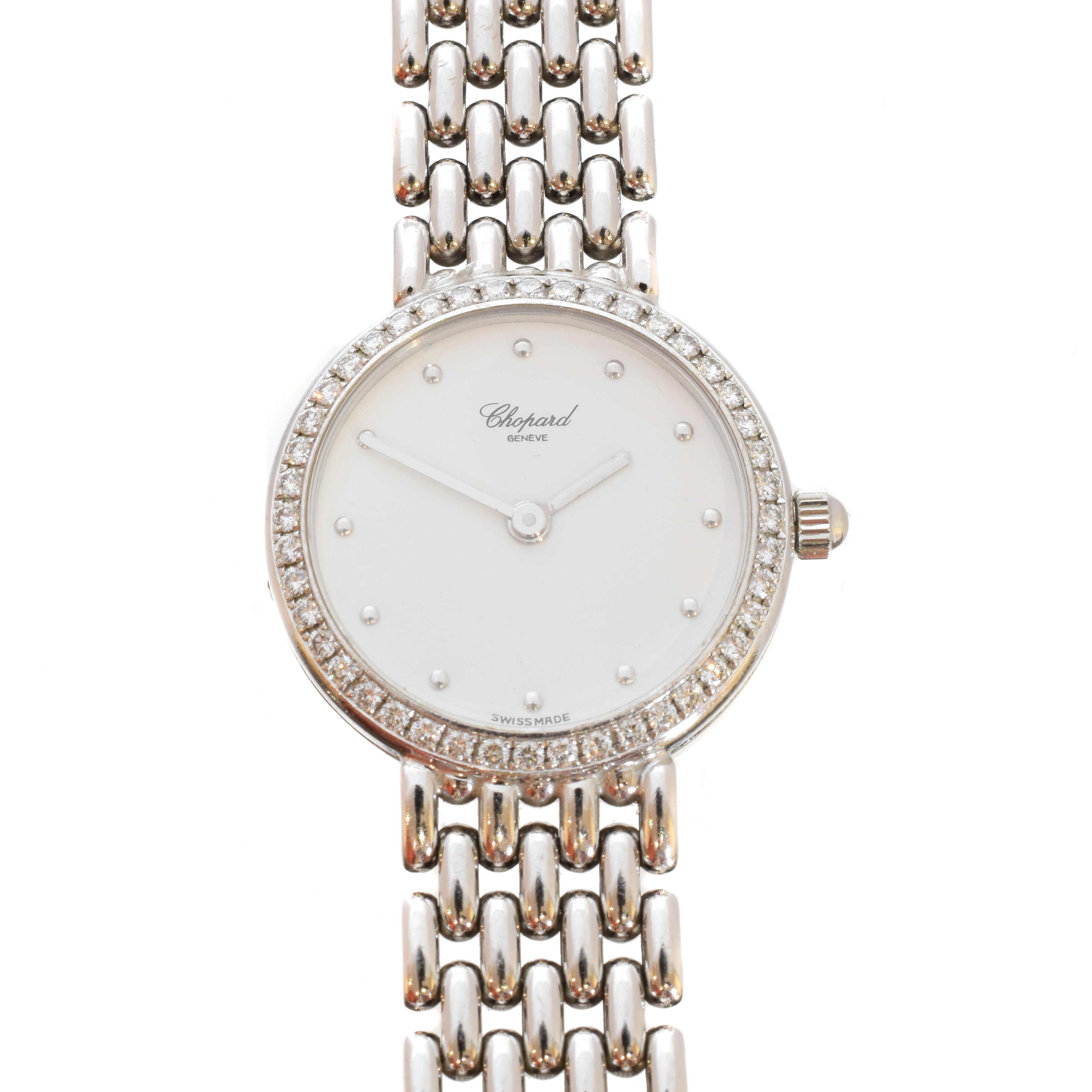 An 18ct gold diamond Chopard watch, the circular signed dial with dot hour markers, diamond set bezel and 18ct gold case numbered 478164, bearing Swiss assay marks, with fancy link bracelet and folding clasp, signed and numbered Chopard 10/5911, case diameter 21mm, gross weight 41.6g.