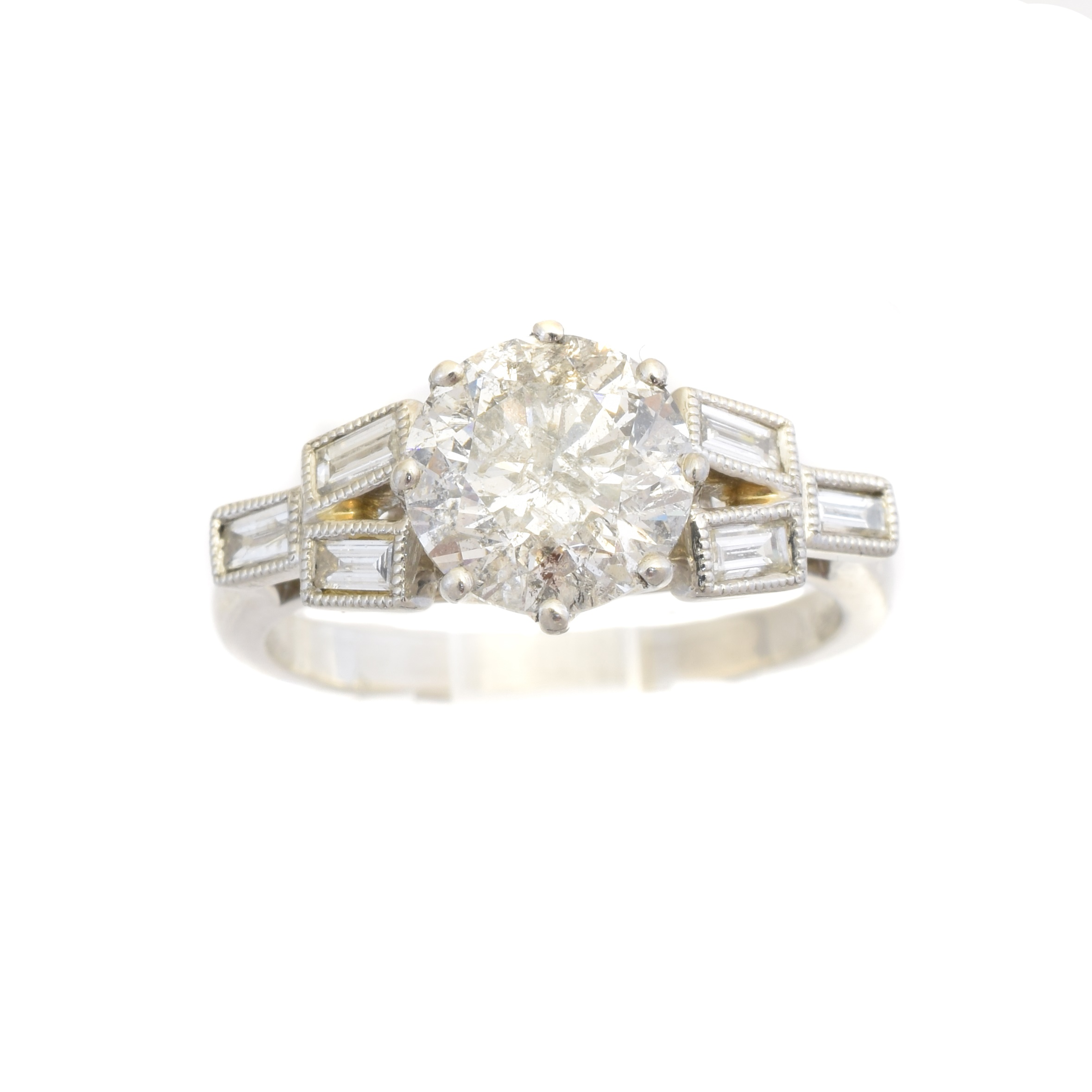 A platinum diamond single stone ring, the brilliant cut diamond with baguette cut diamond trefoil sides, estimated total diamond weight 2.30cts, principal diamond estimated 2.10cts, estimated I-J colour, P1-P2 clarity, hallmarks for Birmingham, ring size O1/2, gross weight 6.2g.