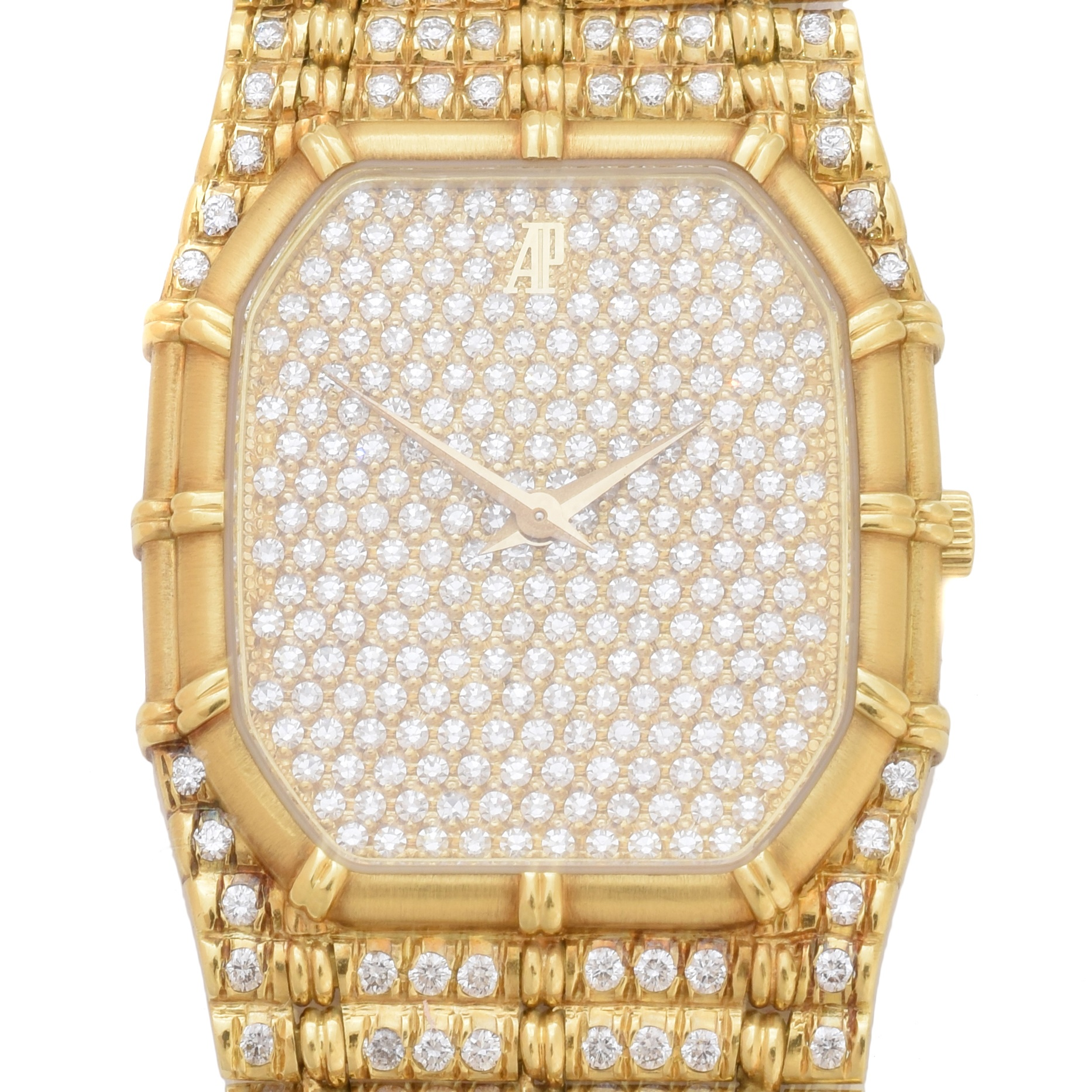 An 18ct gold diamond Audemars Piguet wristwatch, ref C12337, the full diamond set dial with bamboo bezel and similarly set fancy link bracelet with folding clasp, Swiss assay marks, estimated total diamond weight 5.50-6cts, quartz movement, case diameter 27mm, gross weight 89.6g. Sold for £12,200.