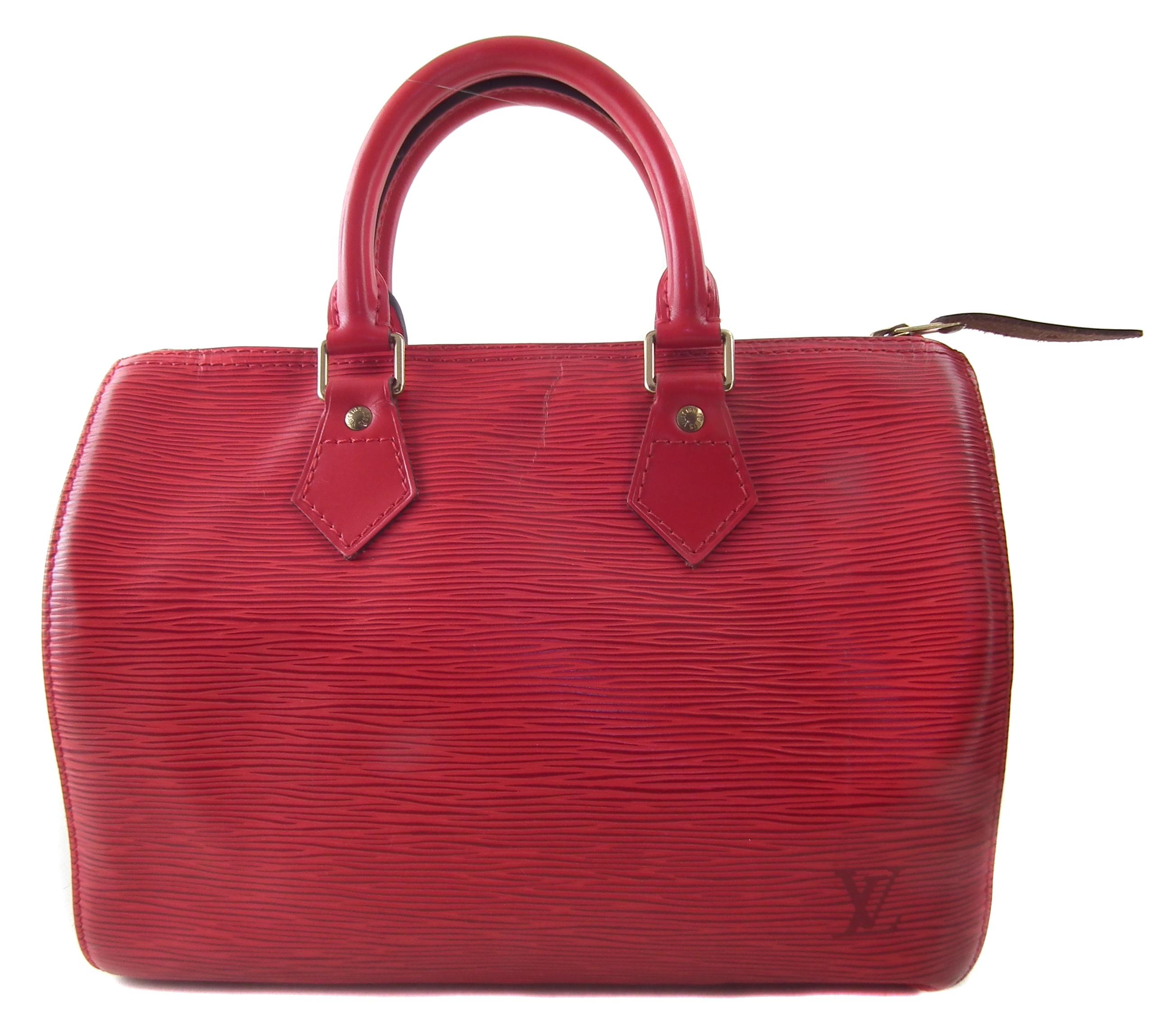 A Louis Vuitton red Epi Speedy 25 handbag
