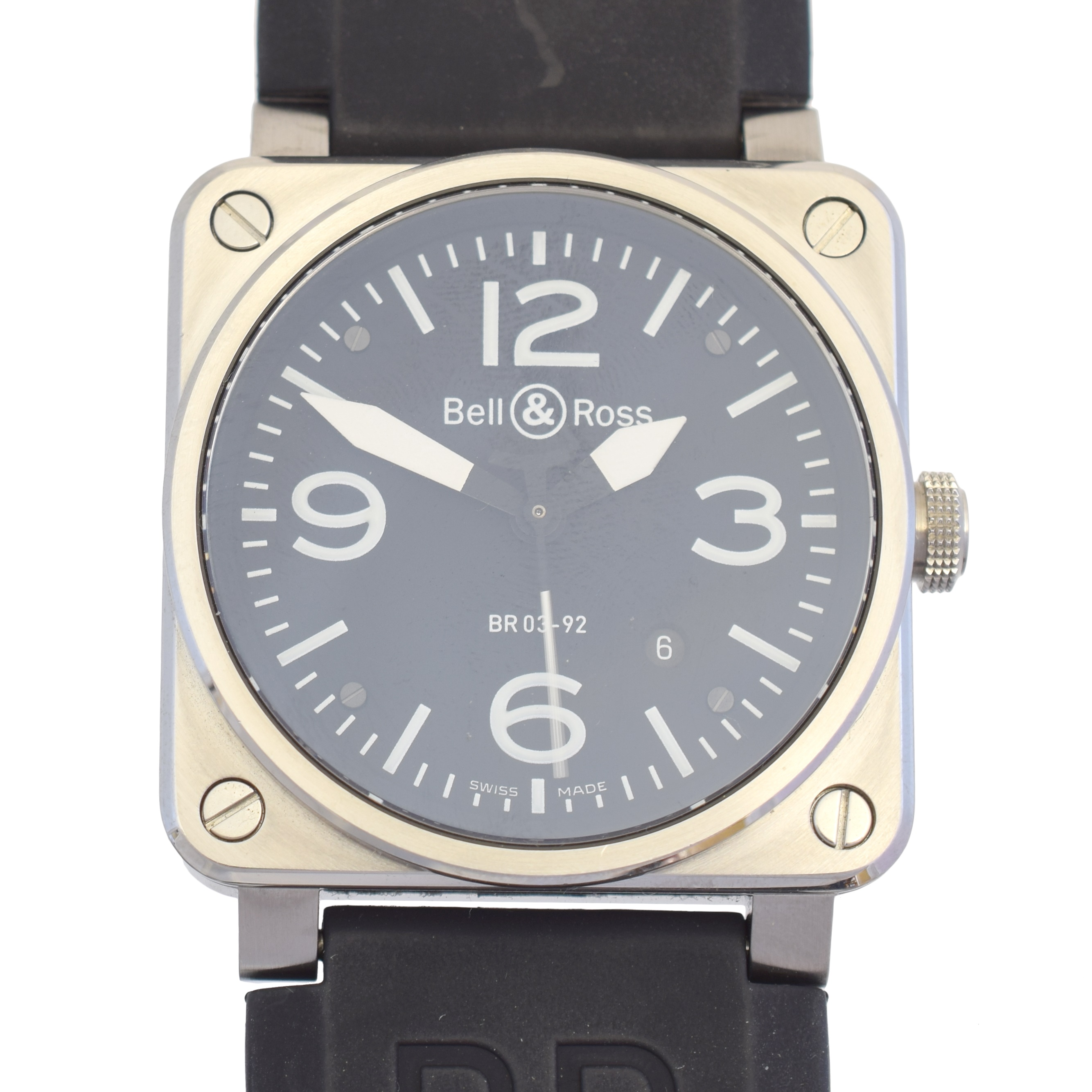 A stainless steel Bell & Ross watch, BR 03-92, the circular black signed dial with Arabic and baton hour markers, date aperture to 5, automatic movement, within a stainless steel square shape case with screw detailing, case back numbered BR 03-92-S011715, with black rubber strap, case width 42mm. With maker's box, technical notes booklet and warranty card.