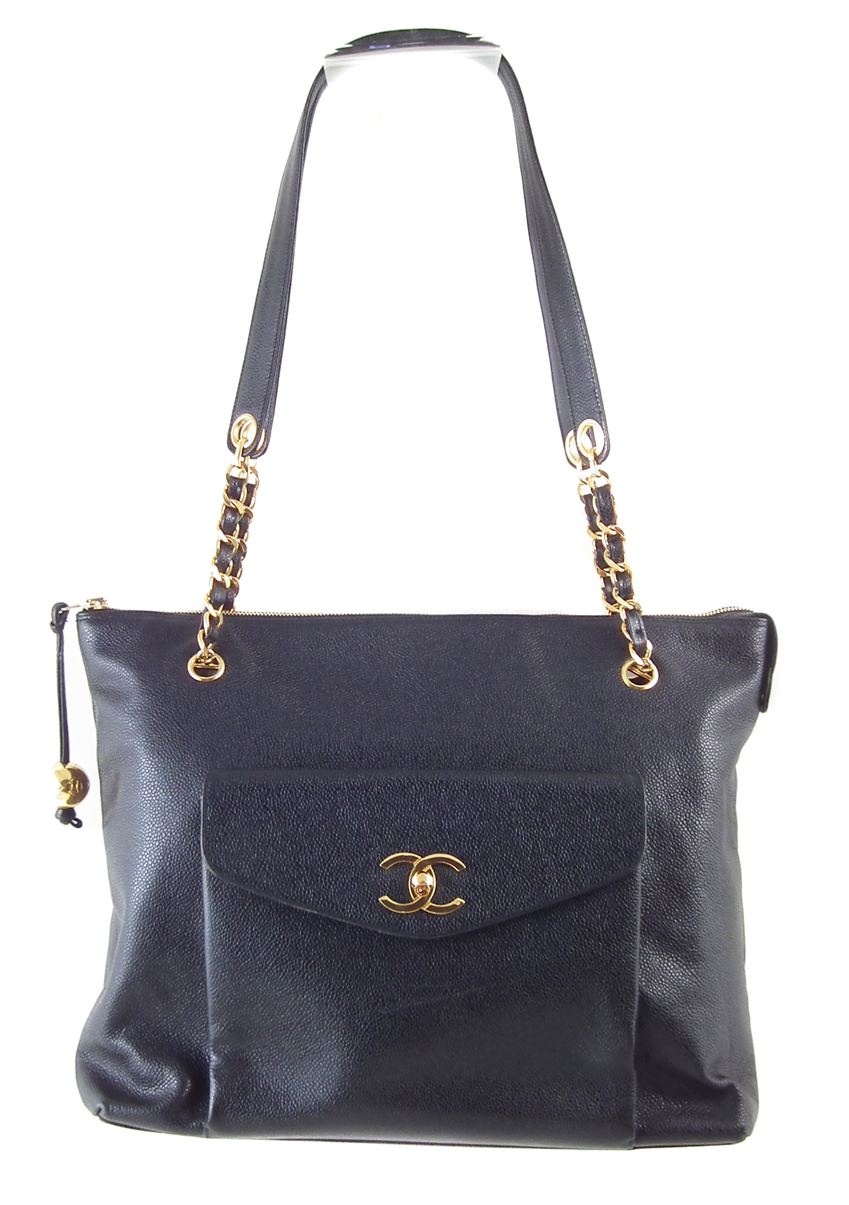 A Chanel CC Turnlock Shopping tote handbag, circa 1991-4, the black caviar leather, with front pocket and gold-tone double 'C' monogram, double woven leather and gold-tone straps with leather shoulder panels, lambskin leather lining, zip compartment, serial number 2896749, with care card and booklet. Dimensions 36 x 30 x 11cm.  36 x 30 x 11cm  Sold for £1,220