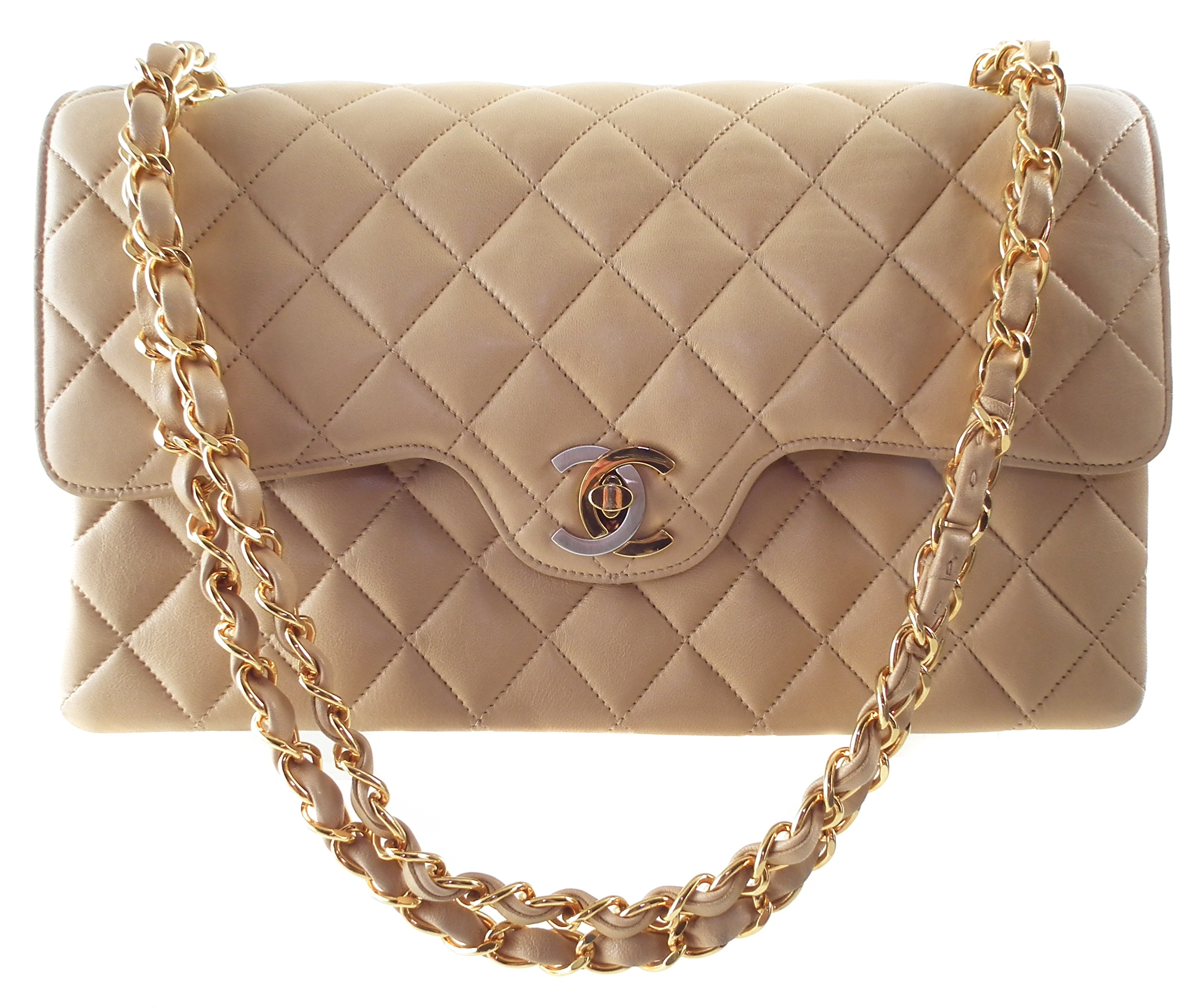 A rare Chanel medium double flap handbag, circa 1991-4, the beige quilted lambskin leather exterior with gold and silver-tone locking clasp, gold-tone double chain shoulder strap, serial number 2827451. Dimensions 26 x 16 x 7cm. With maker's authenticity card.  26 x 16 x 7cm  Sold for £2,196