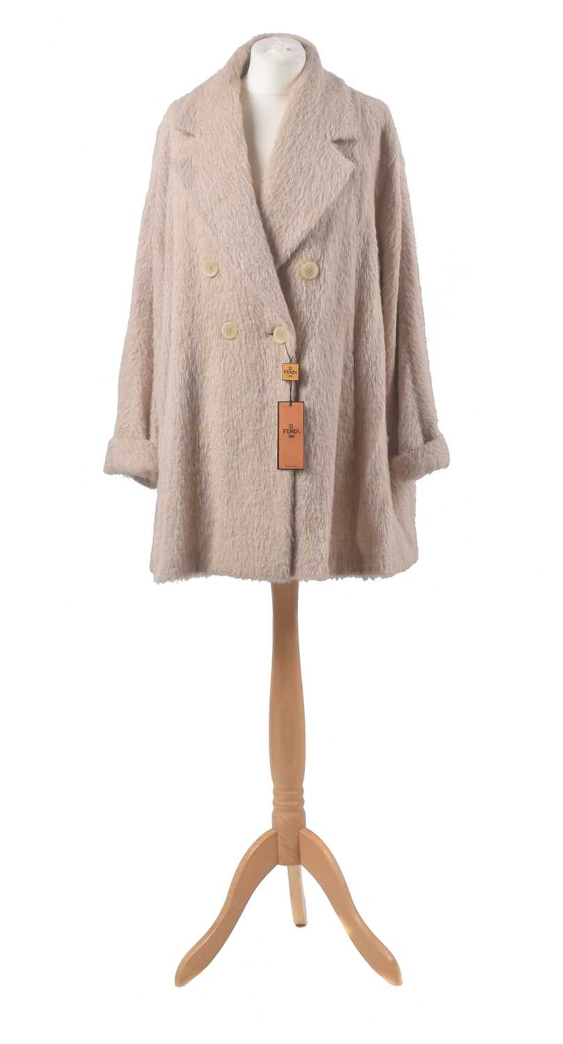 A wool coat by Fendi, the beige wool coat with double breasted buttons and oversized lapel, size 42.
