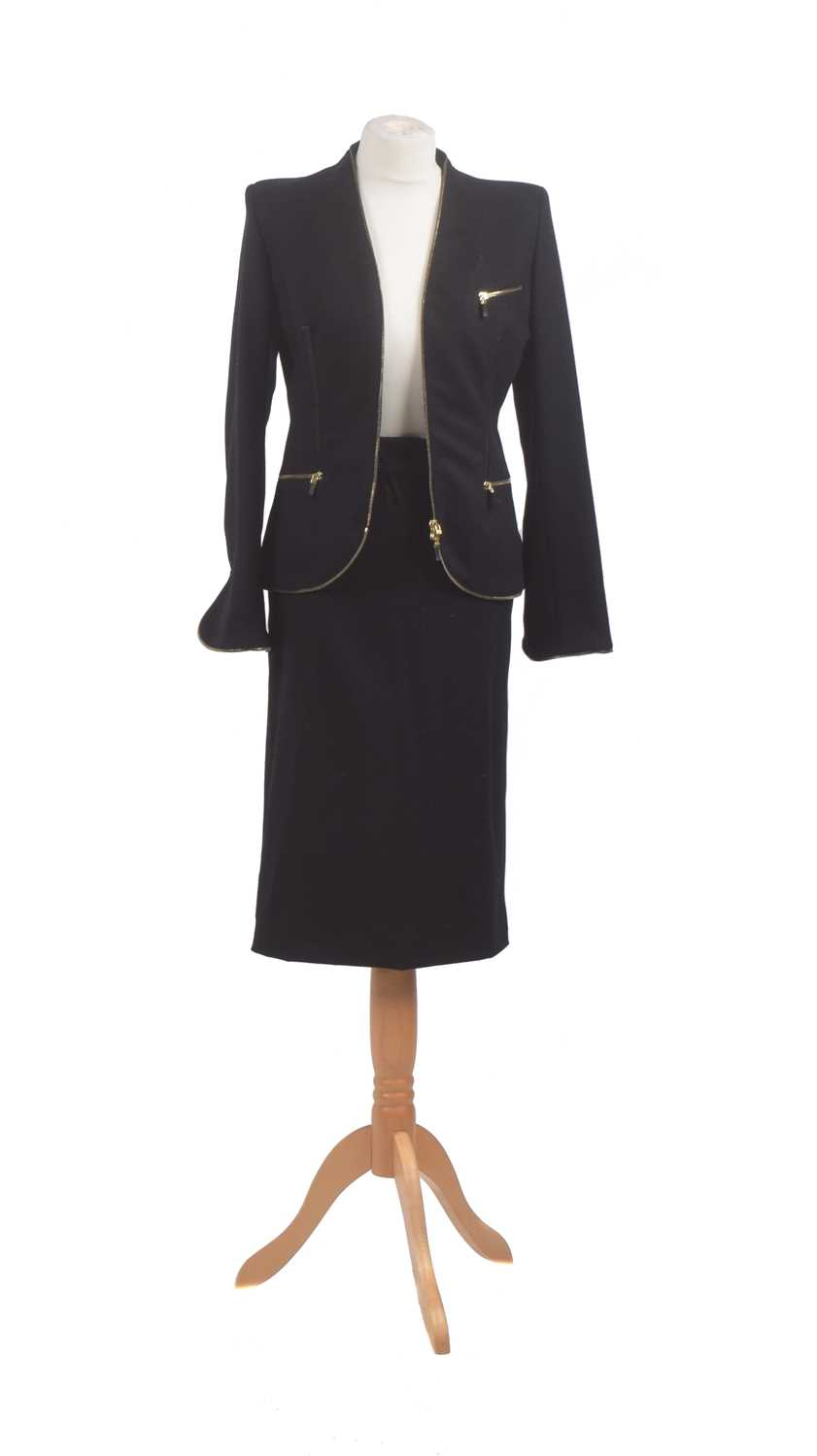 A wool two-piece suit by Alexander McQueen, comprising a mid-length skirt and jacket with gold tone zip detailing, smooth leather accents and black satin lining, size 42.