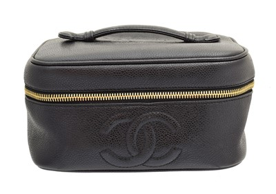A Chanel vanity case, circa 1994-7, the black caviar calf leather cosmetic pouch with stitched monogram detailing, gold-tone hardware and shaped top handle, serial number 3882394, with maker's authenticity card.