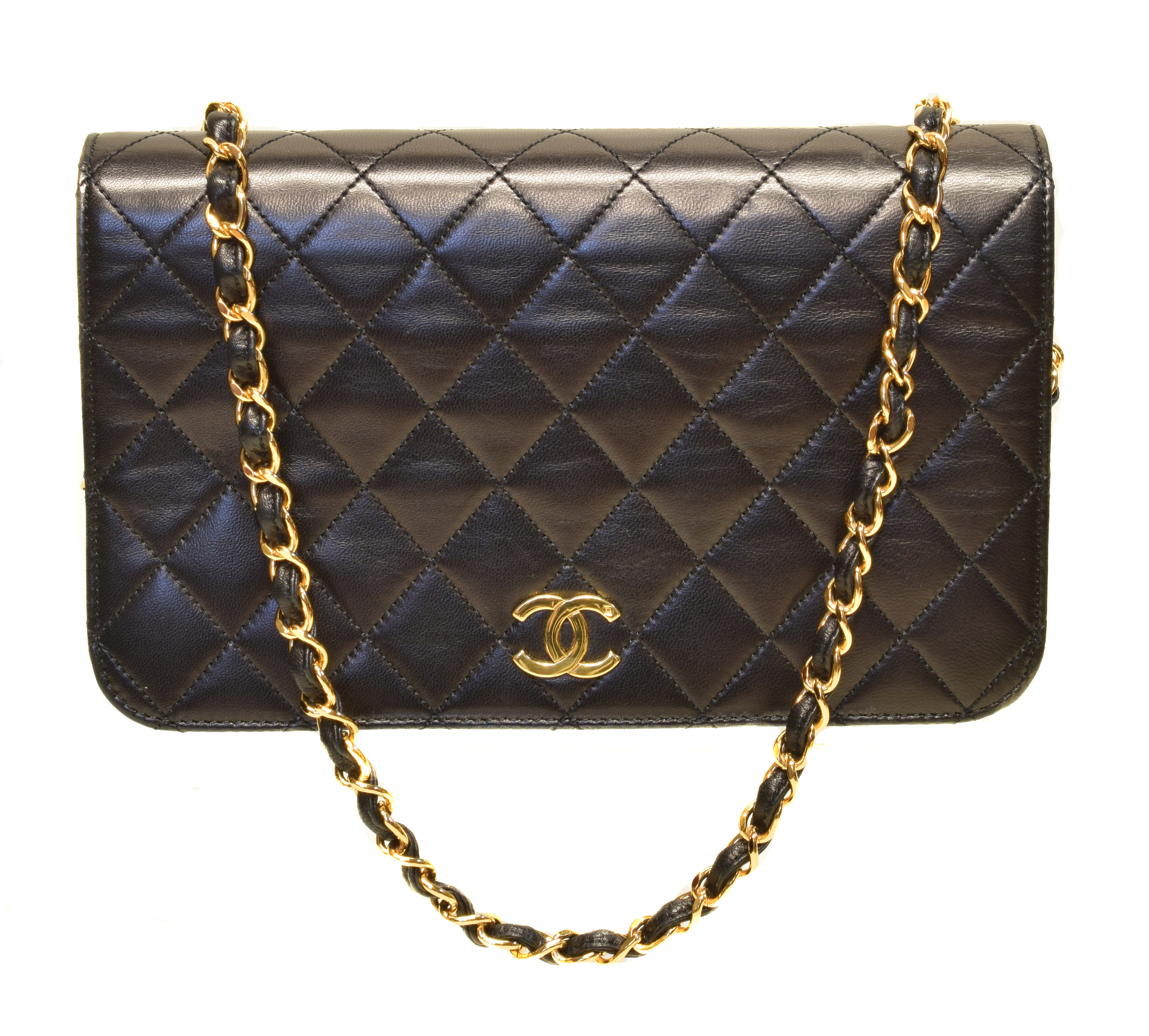 A Chanel Mademoiselle Timeless Full Flap Shoulder Bag, circa 1997-9, the black quilted calf leather exterior with interlaced chain straps and gold tone hardware, serial no. 5145297. With maker's dustbag, card, and box.  (Qty: 1)  23x15x5cm  Sold for £1,952