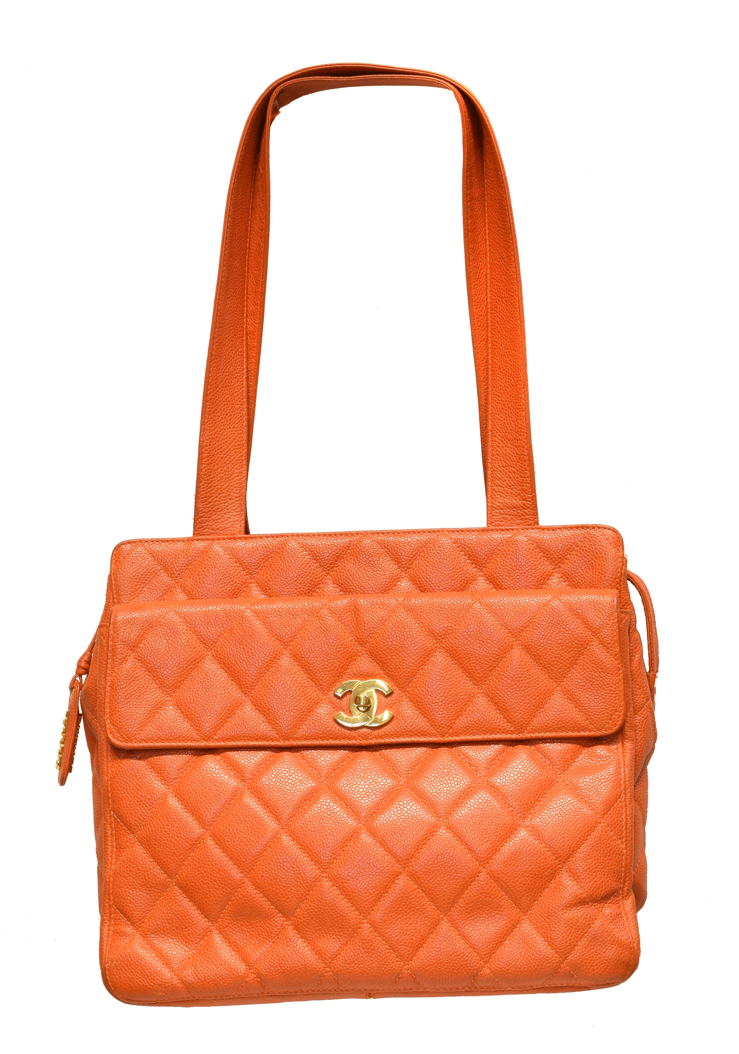 A Chanel Front Pocket Turnlock Tote Shoulder Bag, circa 1996-7, the orange quilted caviar calf leather exterior with orange leather strap and gold tone hardware, serial no. 4112158. With maker's authenticity card.  (Qty: 1)  30x25x10cm  Sold for £1,049