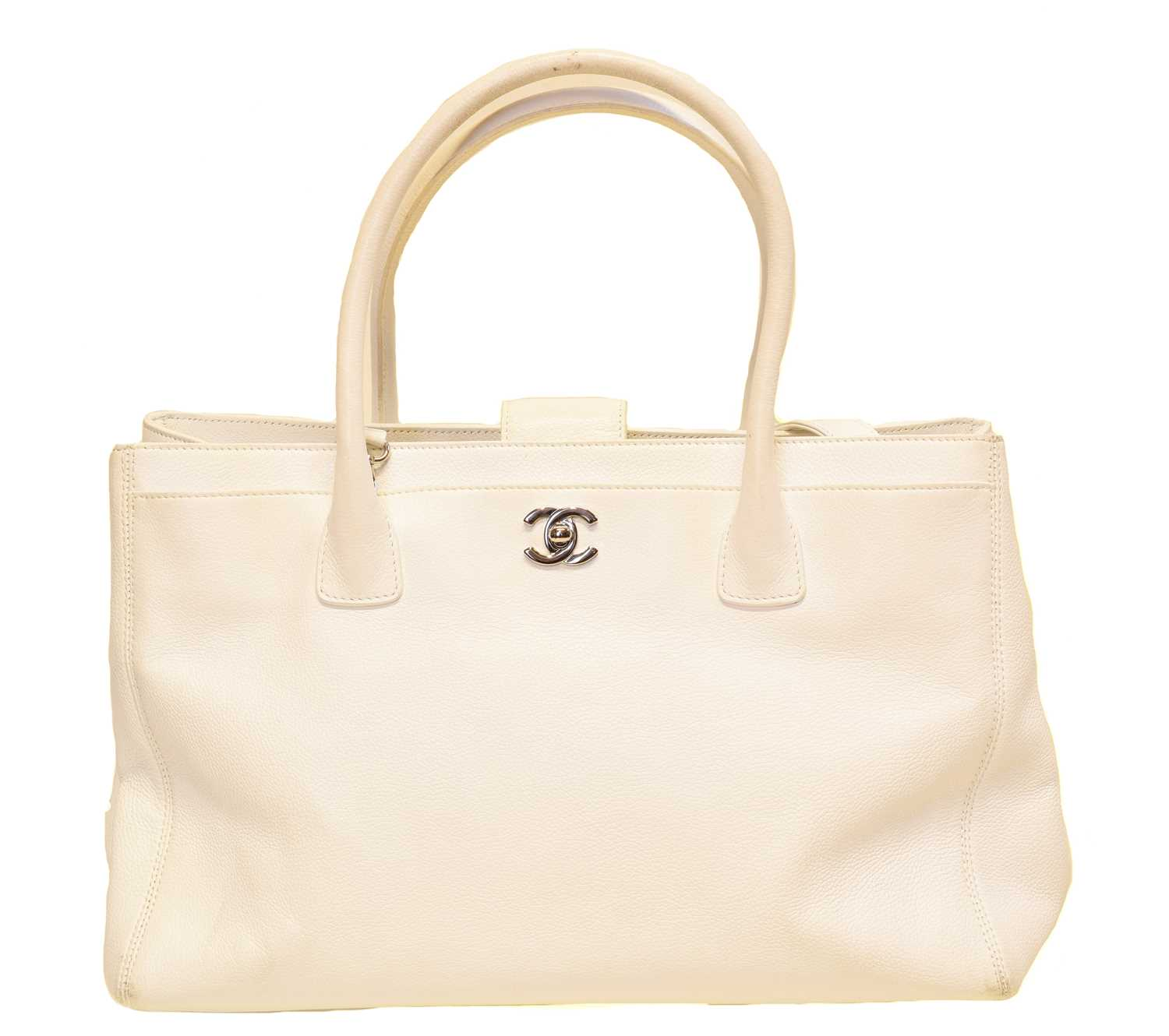 A Chanel Cerf Tote Shoulder Bag, circa 2008-9, the white grained calf leather exterior with white leather straps and silver-tone hardware, serial no. 12381545. With shoulder strap, maker's authenticty card and pouch.