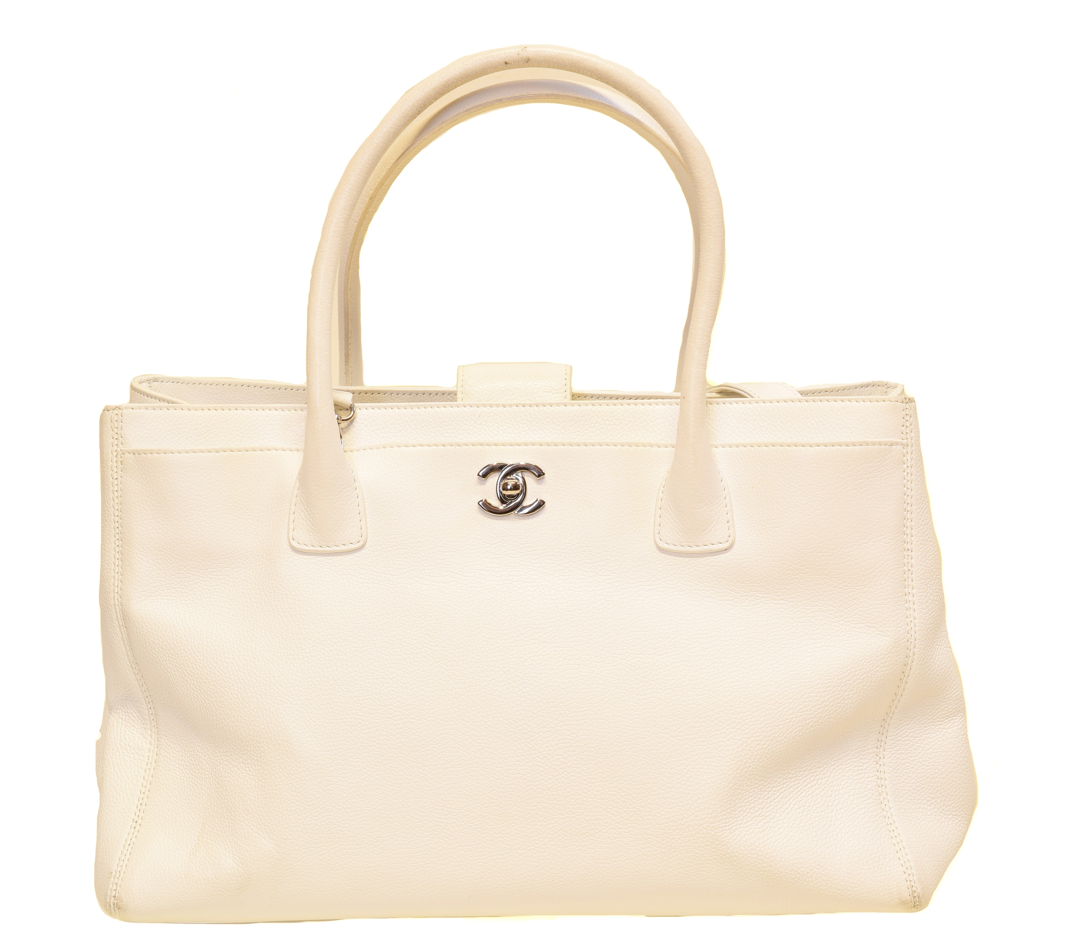 A Chanel Cerf Tote Shoulder Bag, circa 2008-9, the white grained calf leather exterior with white leather straps and silver-tone hardware, serial no. 12381545. With shoulder strap, maker's authenticty card and pouch.  (Qty: 1)  35.5x23.5x12cm  Sold for £1,269