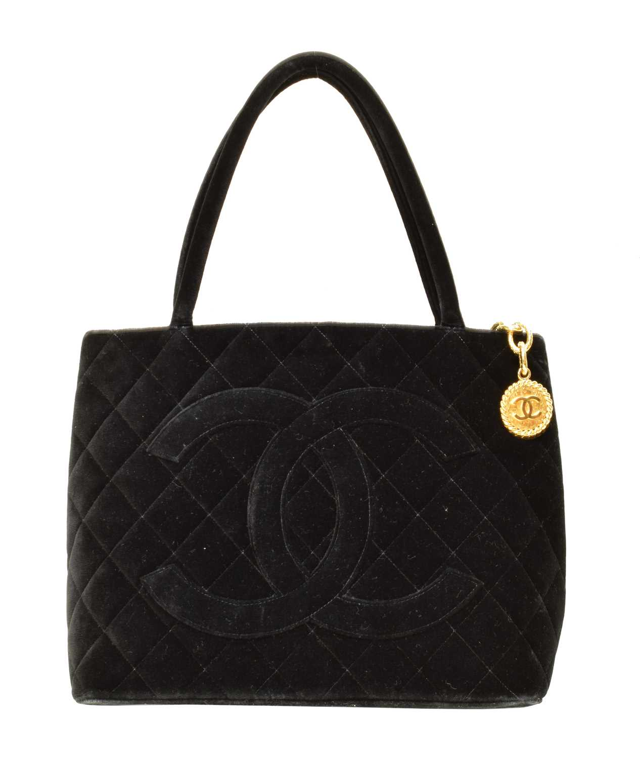 A Chanel Medallion Shoulder Bag, circa 1997-9, the black velvet quilted canvas exterior with black canvas strap and gold tone hardware, serial no. 5411744.