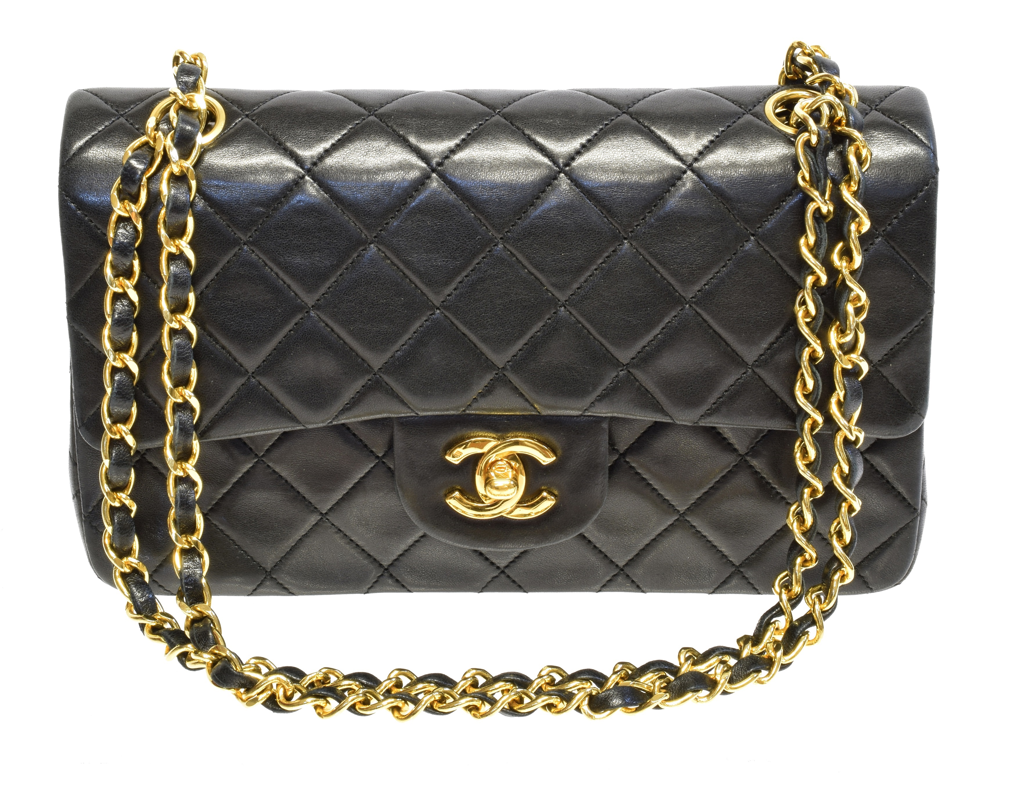 A Chanel Classic Double Flap Bag, circa 1989-91, the black quilted leather exterior with gold-tone hardware and chain handles, serial no. 1601799, with maker's authenticity card.  23x15x6.8cm  Sold for £3,538