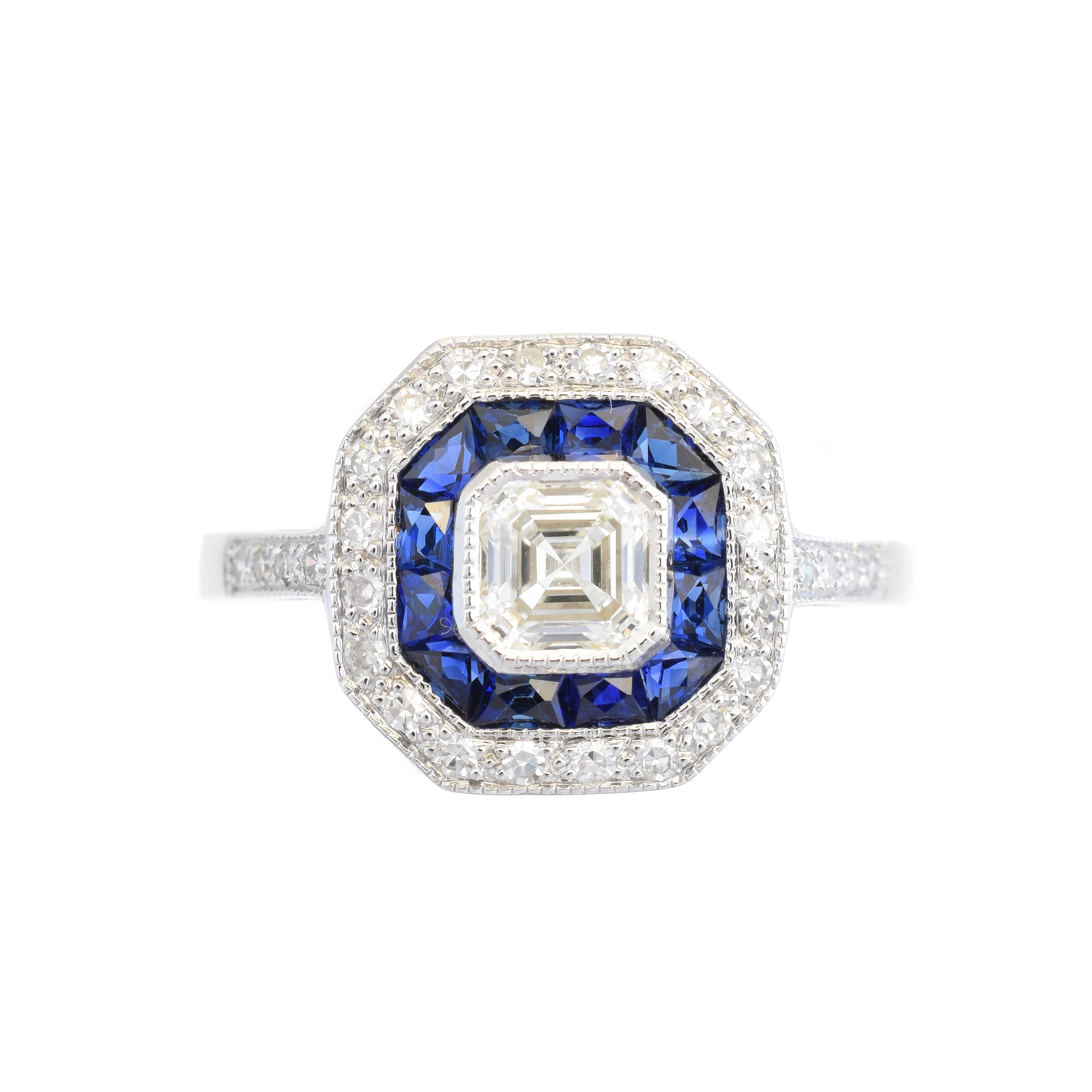 A diamond and sapphire cluster ring, the Asscher cut diamond within a calibré cut sapphire and single cut diamond surround, to the similarly cut diamond shoulders, estimated total diamond weight 0.65ct, principal diamond estimated 0.50ct, estimated colour J-K, estimated clarity VS, stamped 750, ring size N1/2, gross weight 3g.