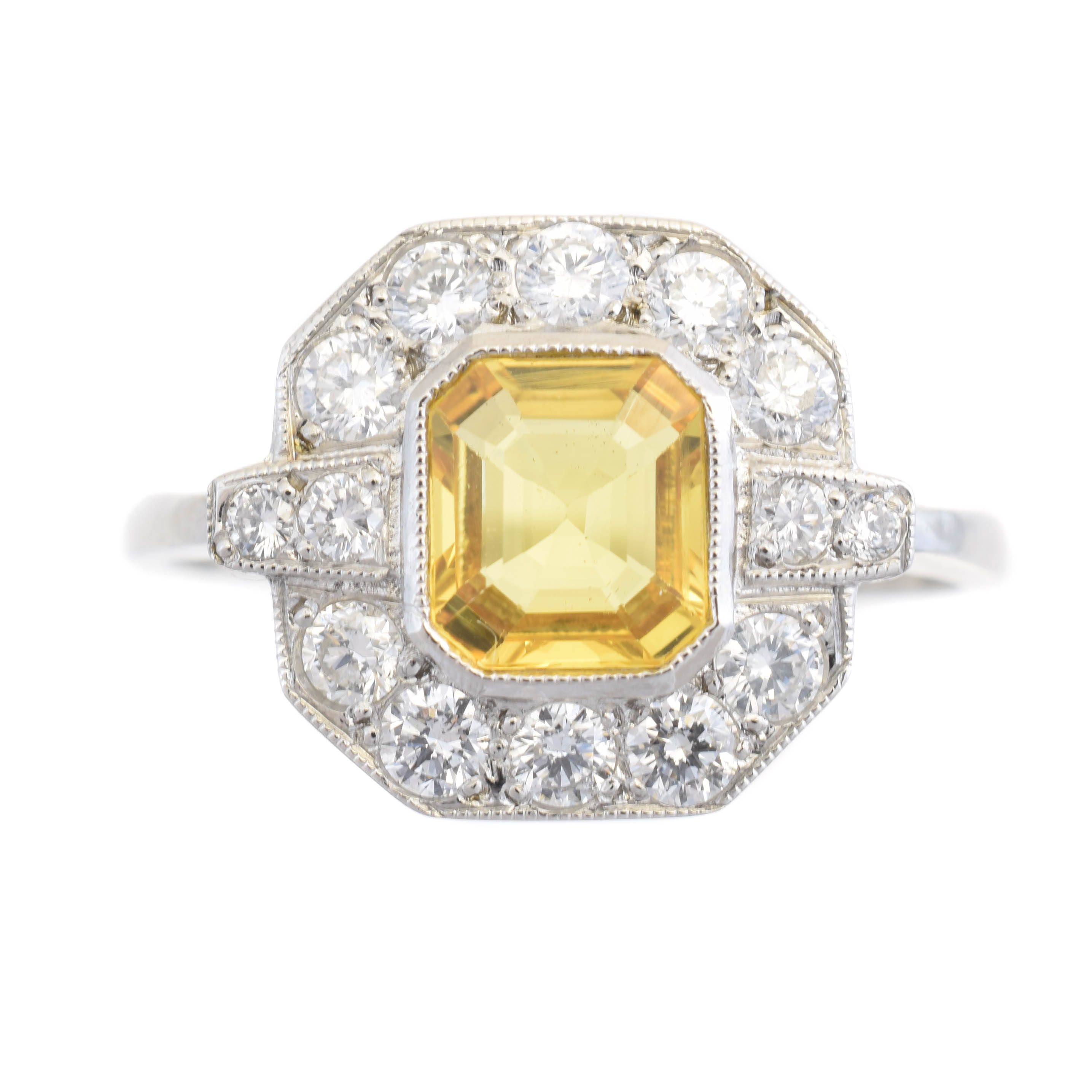 A sapphire and diamond cluster ring, the rectangular shape yellow sapphire weighing approx. 1ct within a brilliant cut diamond surround and similarly cut diamond sides, estimated total diamond weight 0.50ct, stamped PLAT, ring size O1/2, gross weight 4.8g.