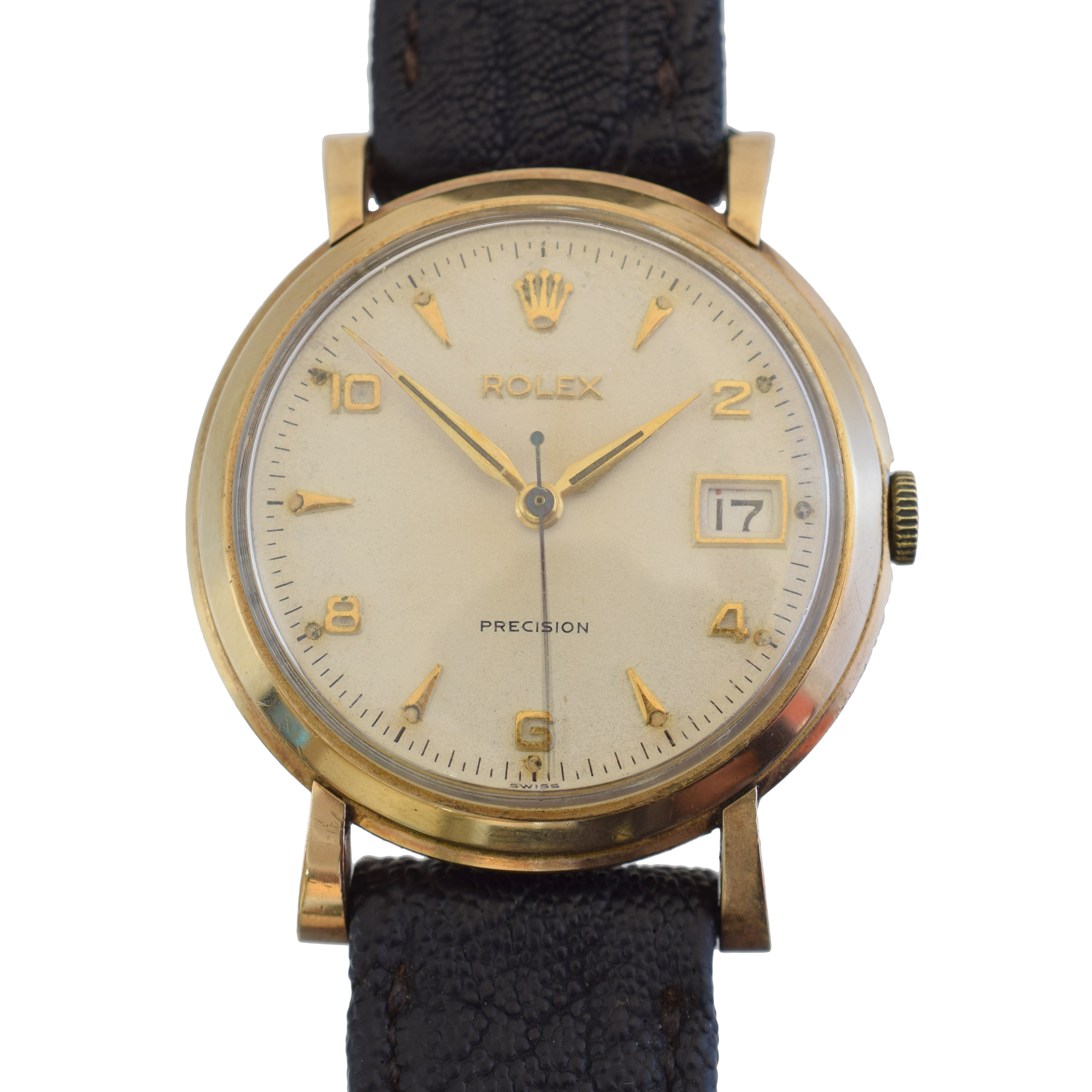 A 1950s 9ct gold cased Rolex Precision wristwatch, cal 1210, the circular signed dial with baton and Arabic hour markers, outer minutes track and red/black date aperture to 3, signed 17 jewel movement numbered 73337, within a 9ct gold case bearing hallmarks for London, 1954, numbered 238, and later leather strap, case diameter 33mm.