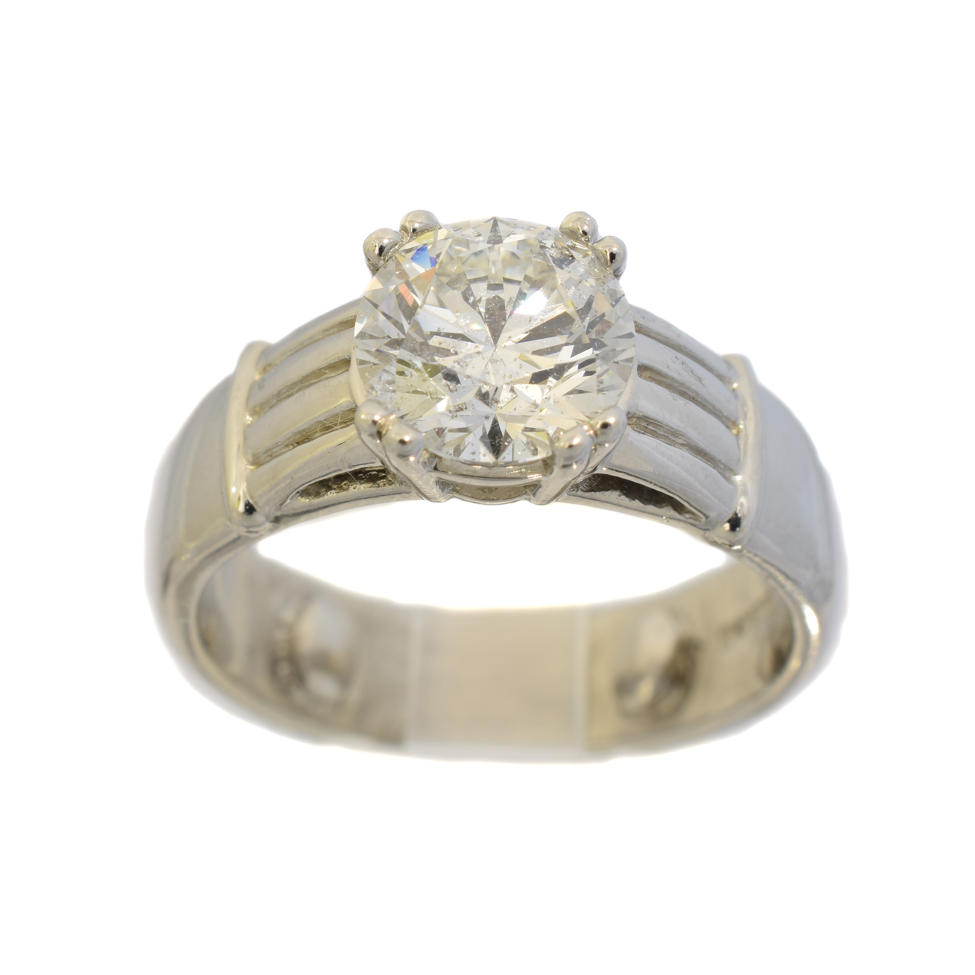 A platinum diamond single stone ring, the brilliant cut diamond weighing 2.21cts within a four claw setting, to the grooved shoulders, hallmarks for Sheffield, ring size Q, gross weight 13.6g. Accompanied by a certificate from E.G.L numbered EGL3201067120 stating that the diamond is D colour, SI2 clarity.