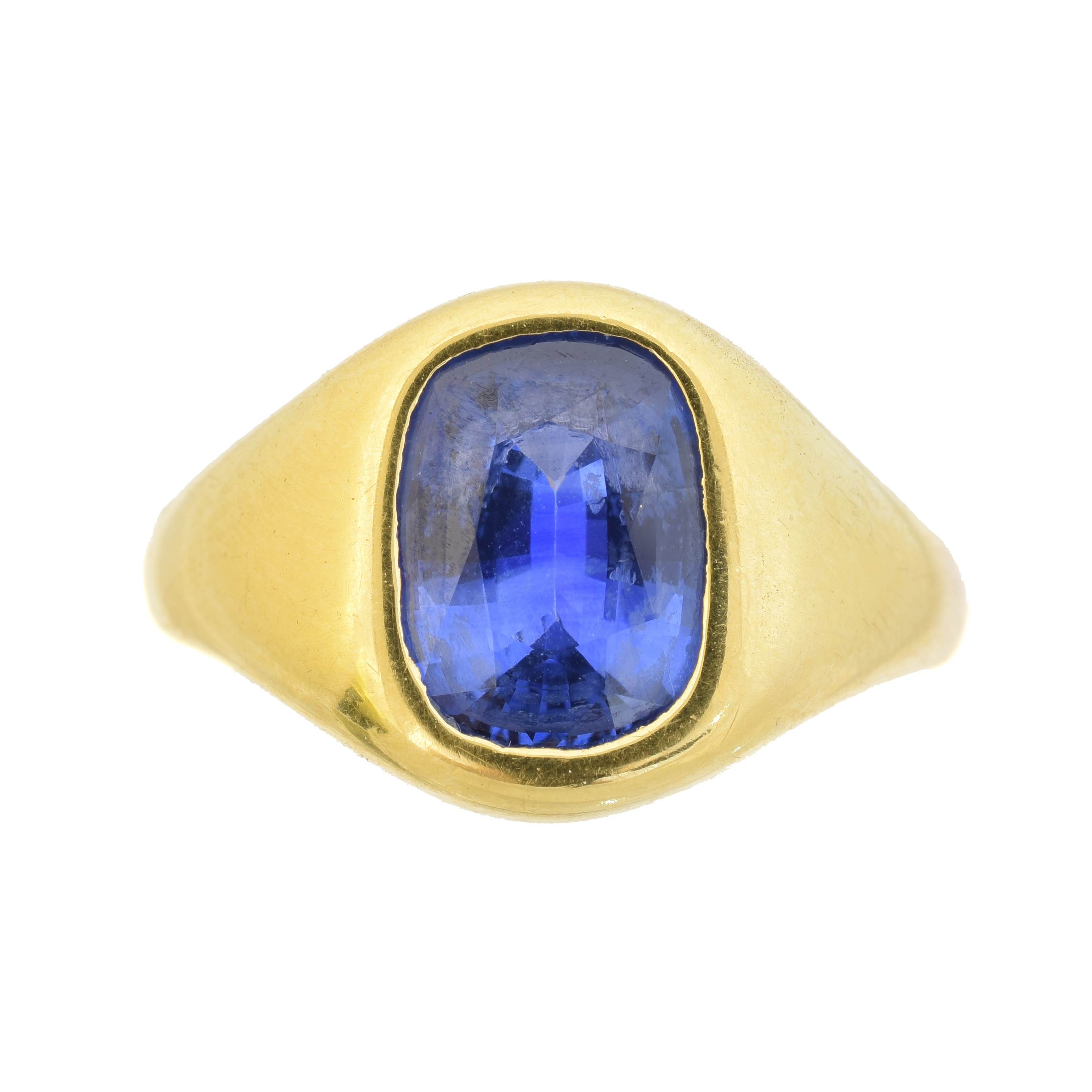 An 18ct gold sapphire single stone ring, the oval shape sapphire inset to the signet ring, hallmarks for Birmingham, ring size S, gross weight 12.2g.