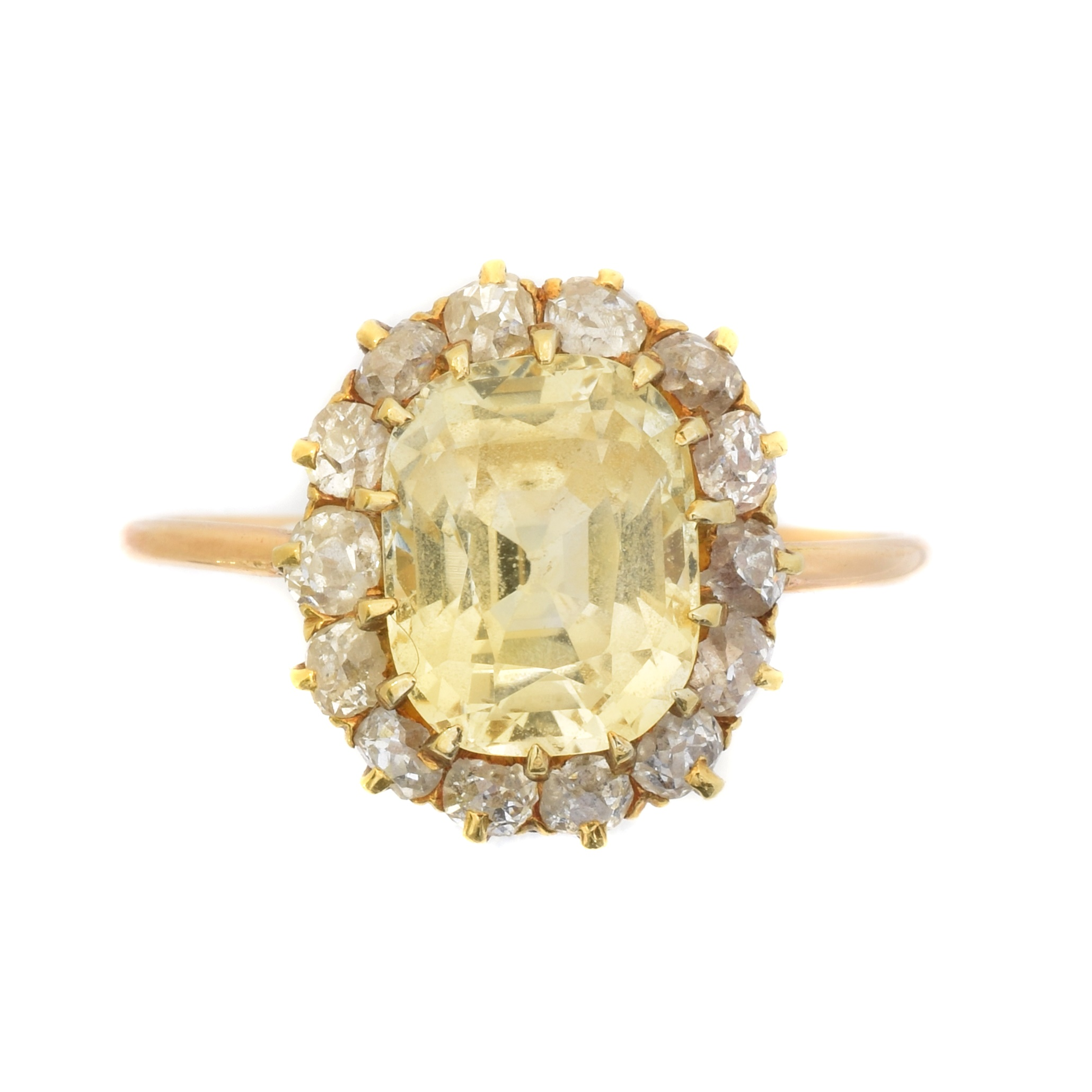 A sapphire and diamond cluster ring, the cushion shape yellow sapphire weighing approx. 3.50cts within an old cut diamond surround, estimated total diamond weight 0.70ct, ring size P1/2, gross weight 3.2g.
