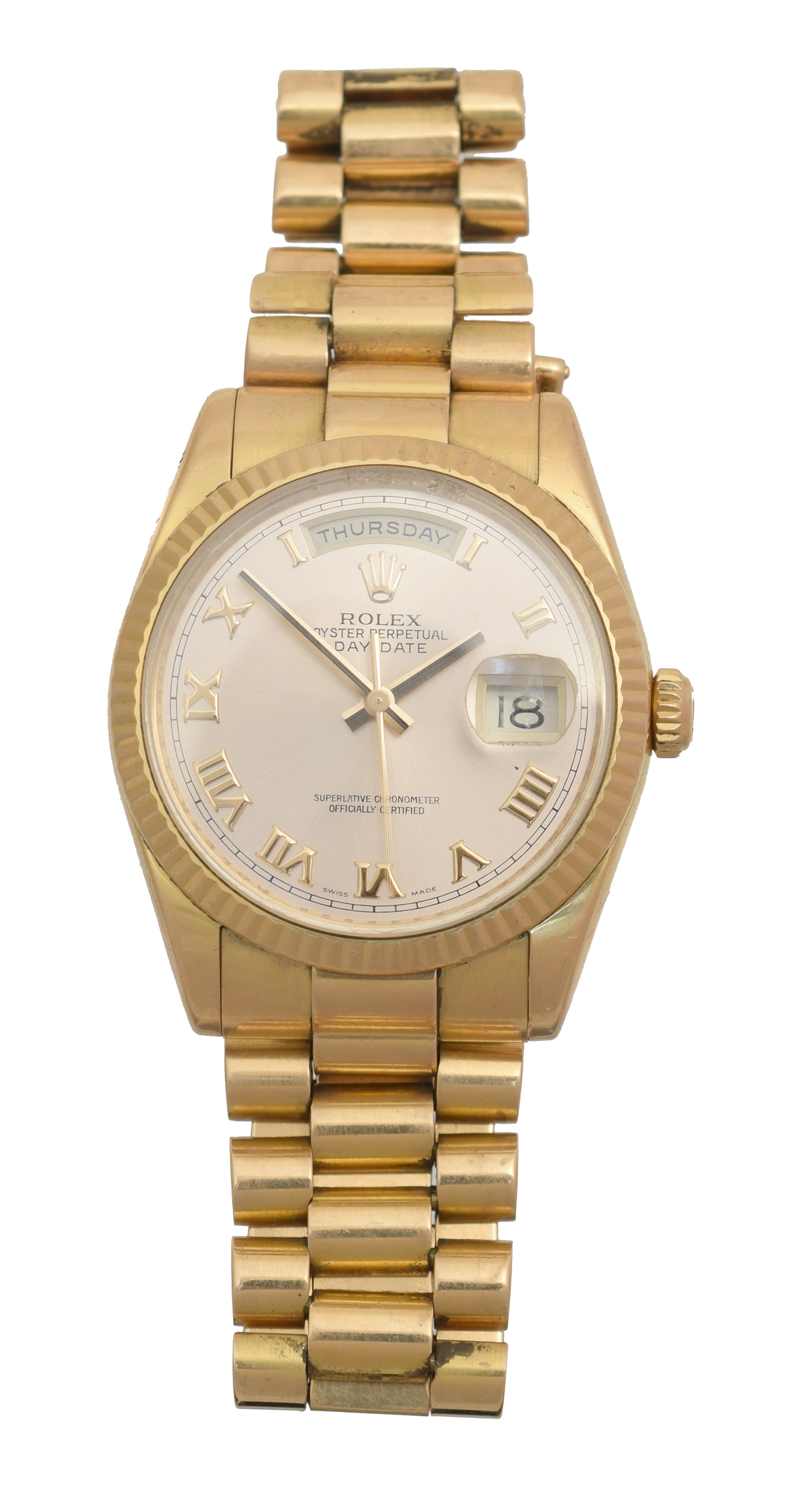 A gents 18ct gold Rolex Oyster Perpetual Day-Date wristwatch, circa 2006-7, the circular signed dial with Roman numeral hour markers, date aperture to 3 and day aperture to 12, with fluted bezel and president bracelet, model no. 118235, Z349629, Swiss assay marks, case diameter 40mm, with single spare link and papers.