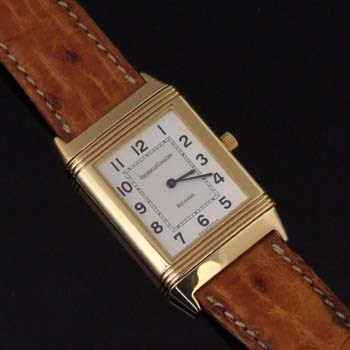 An 18ct gold Jaeger-LeCoultre Reverso wristwatch, circa 1990, the rectangular signed silvered dial with arabic numerals, sapphire glass, turn-over case 22 x 39mm overall, quartz movement, on Jaeger-LeCoultre leather strap. With maker's box and booklet.