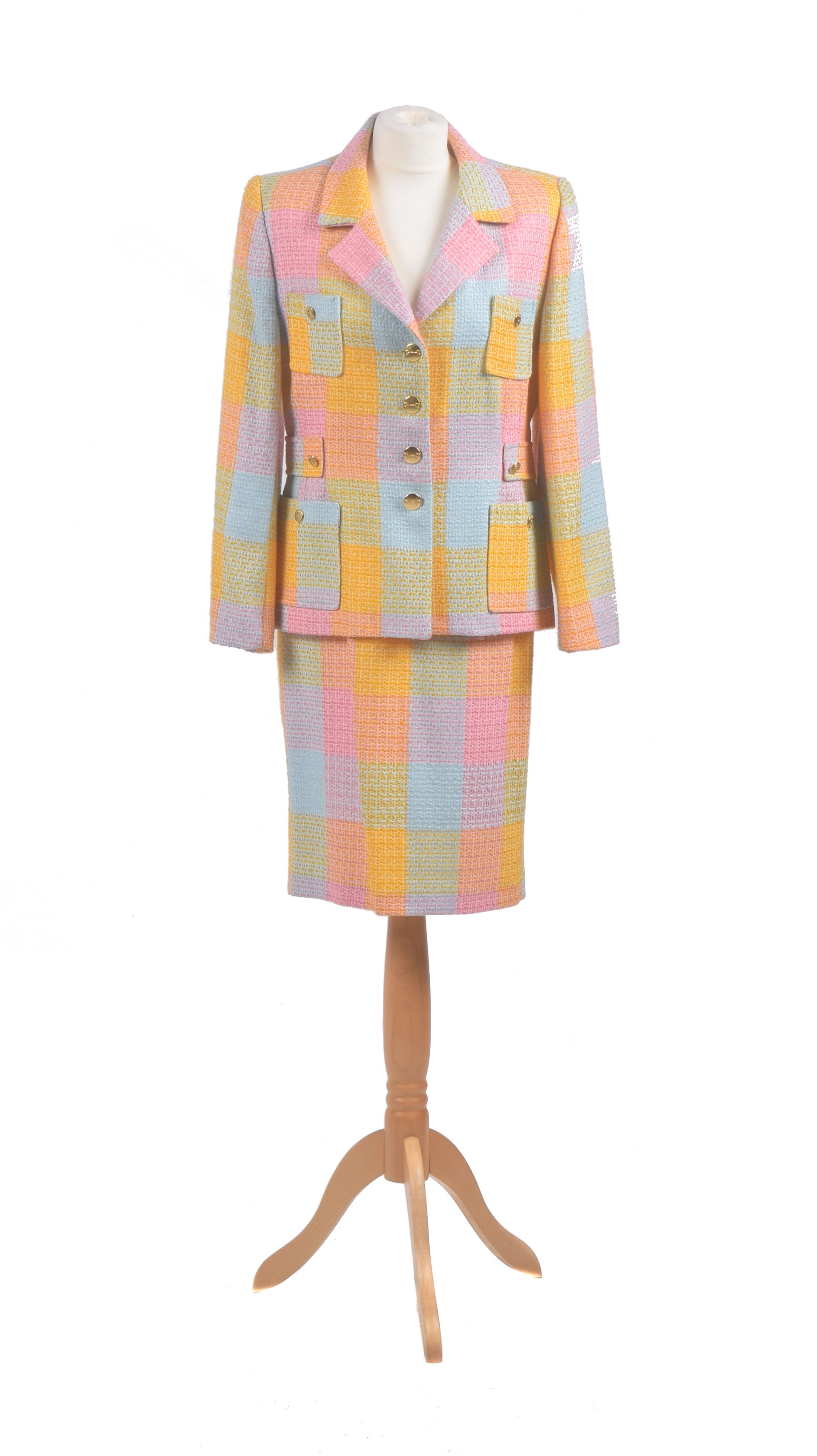 A suit by Helena Stern, comprising a mid-length skirt and jacket in pink, blue and yellow woven wool with gold tone buttons, size 42.