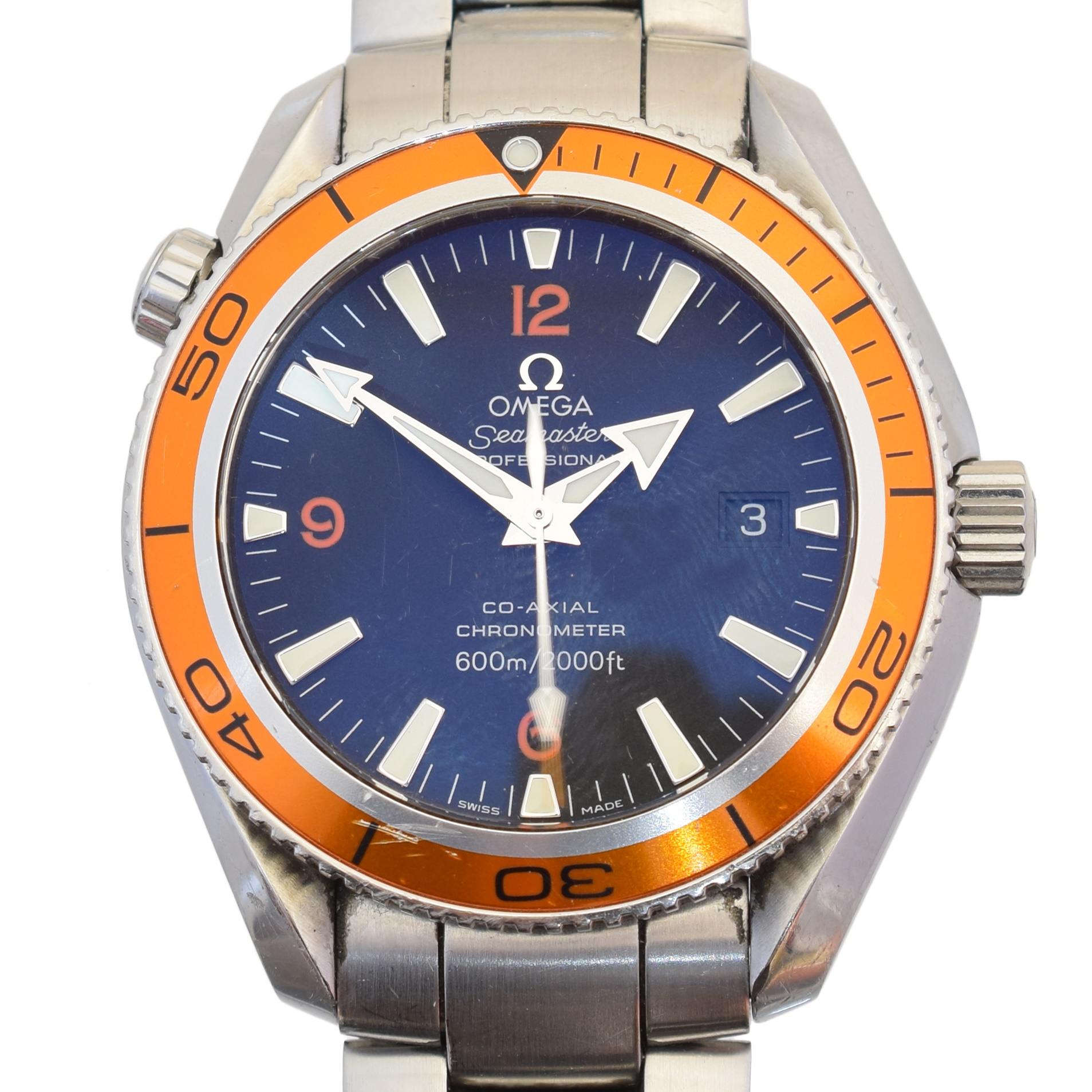 A stainless steel Omega Seamaster Planet Ocean watch, circa 2006, ref. 22095000, the circular black signed dial with orange arabic quarter markers and baton hour markers, with date aperture to 3 and orange bezel, automatic movement cal. 2500, serial no. 80949140, with stainless steel bracelet and folding clasp, case diameter 43mm. With maker's box, booklet and international warranty cards. Sold for £2,318