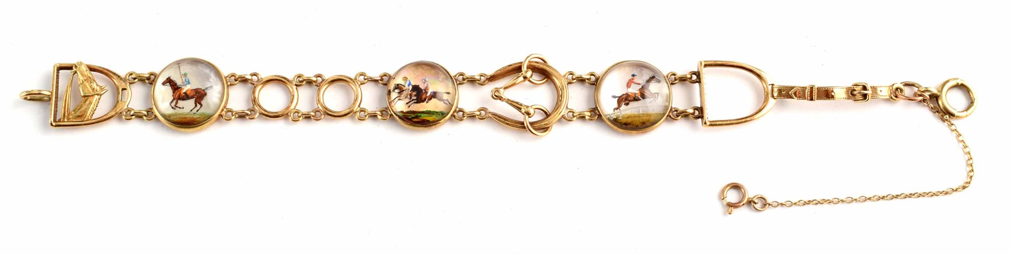 An early 20th century Essex Crystal bracelet, of horse racing interest, comprising a trio of round rock crystal reverse carved intaglio horse racing scenes, within a fancy link chain with stirrup and horse head links, the central intaglio link stamped '14k, PAT.SEPT.1924' length 18cm, with Martin & Co, Cheltenhnam box.