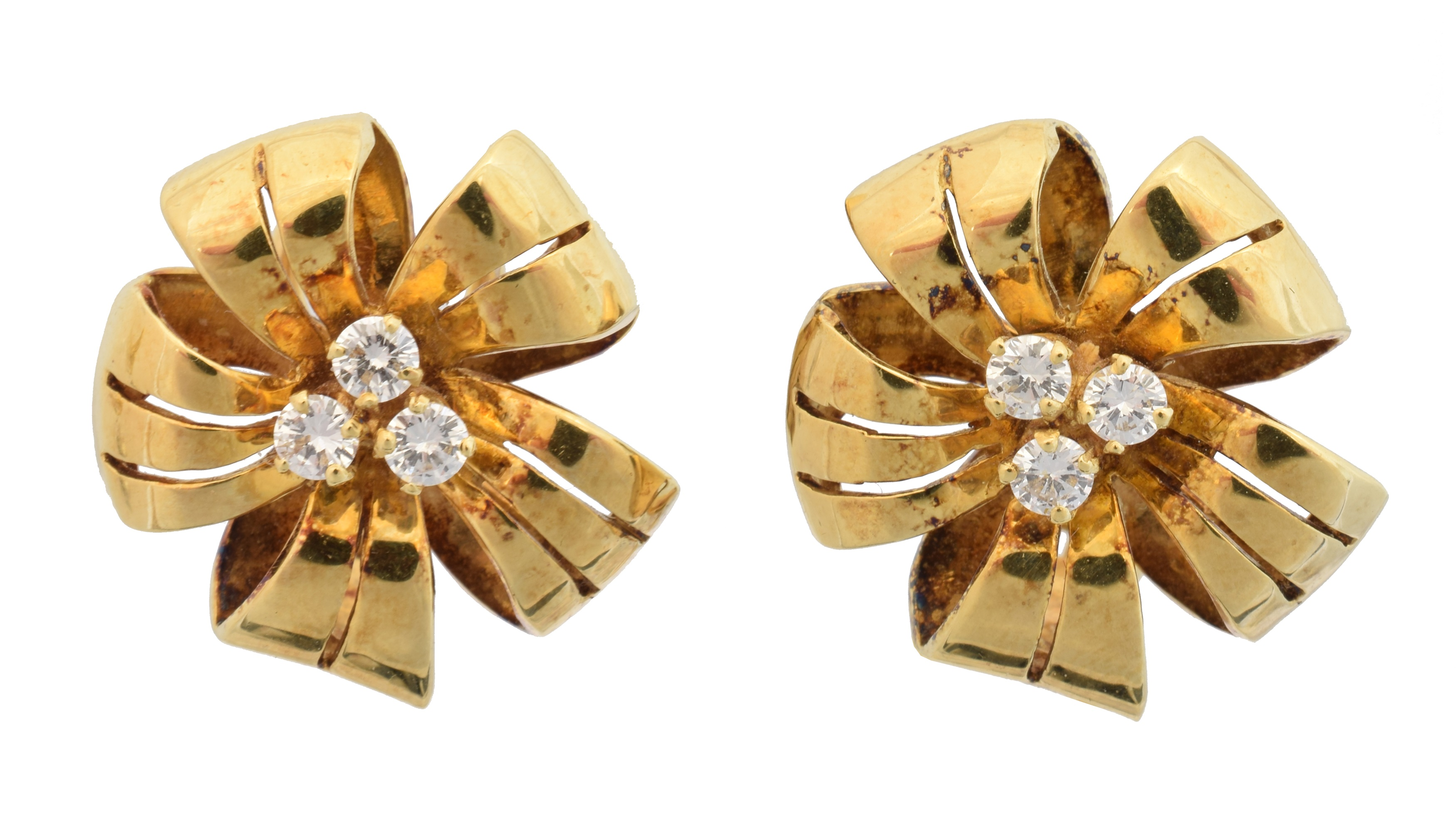 A pair of 18ct gold diamond floral earrings by Cropp & Farr, each designed as a brilliant cut diamond trefoil, within a pierced floral surround, estimated total diamond weight 0.40ct, maker's marks for Cropp & Farr, hallmarks for London, 1994, length 2cm, gross weight 12.4g.