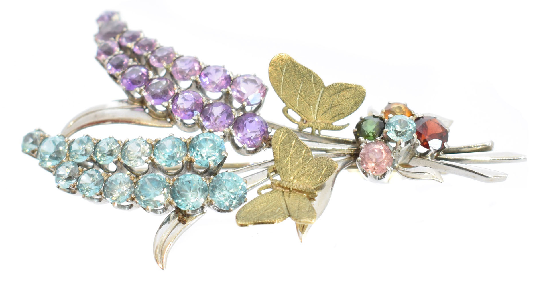 A Cropp & Farr multi-gem spray brooch, the circular shape zircon and amethyst floral sprigs with textured butterfly accents and zircon, tourmaline, citrine and garnet cluster to ribbon, makers marks for Cropp & Farr, stamped 9ct, 5963, length 6.2cm, gross weight 13.7g.