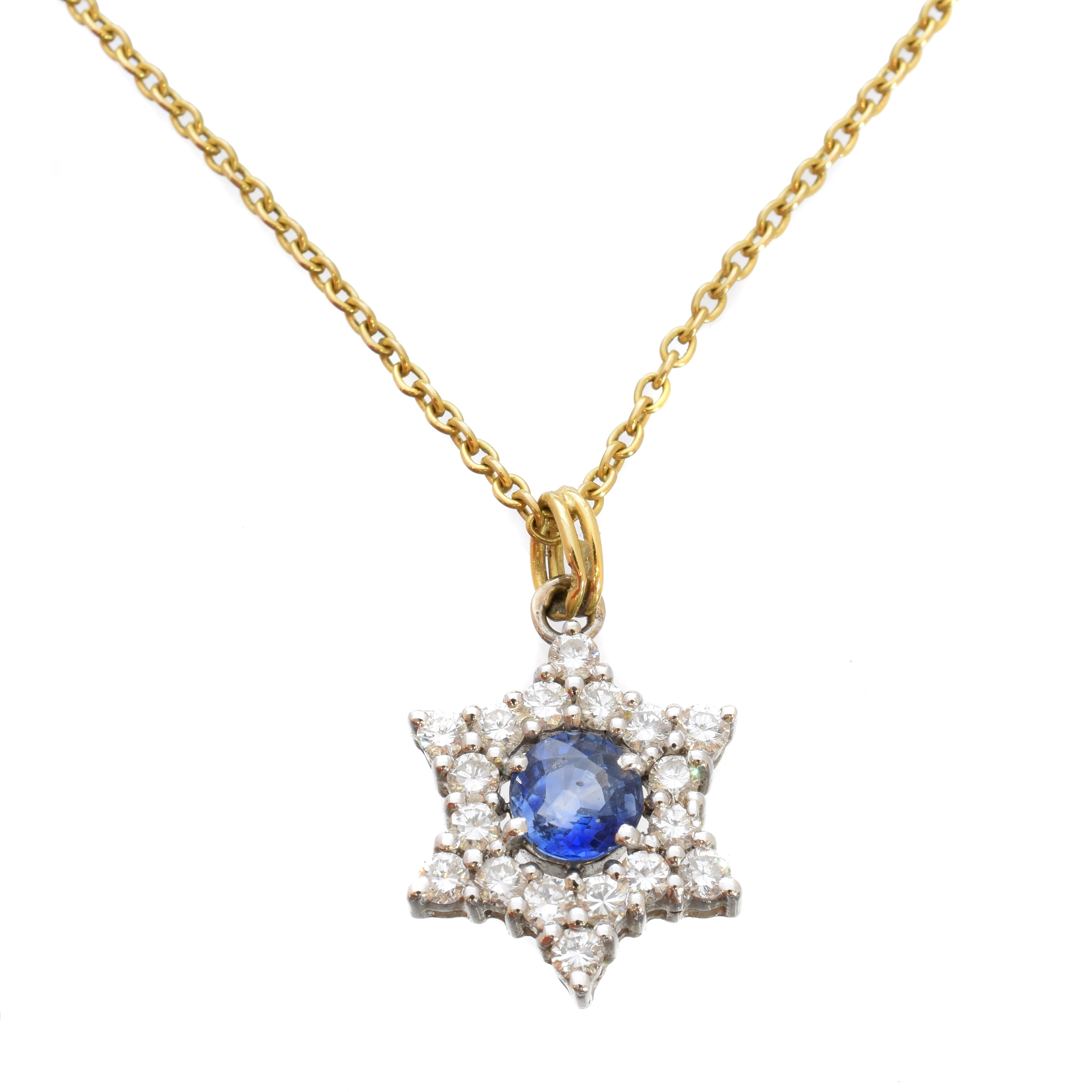 A sapphire and diamond pendant, the circular shape sapphire within a brilliant cut diamond star shape surround, stamped 750, suspended from a Cropp & Farr 9ct gold chain, estimated total diamond weight 0.55ct, length of pendant 2.2cm, length of chain 41cm, gross weight 4.4g.