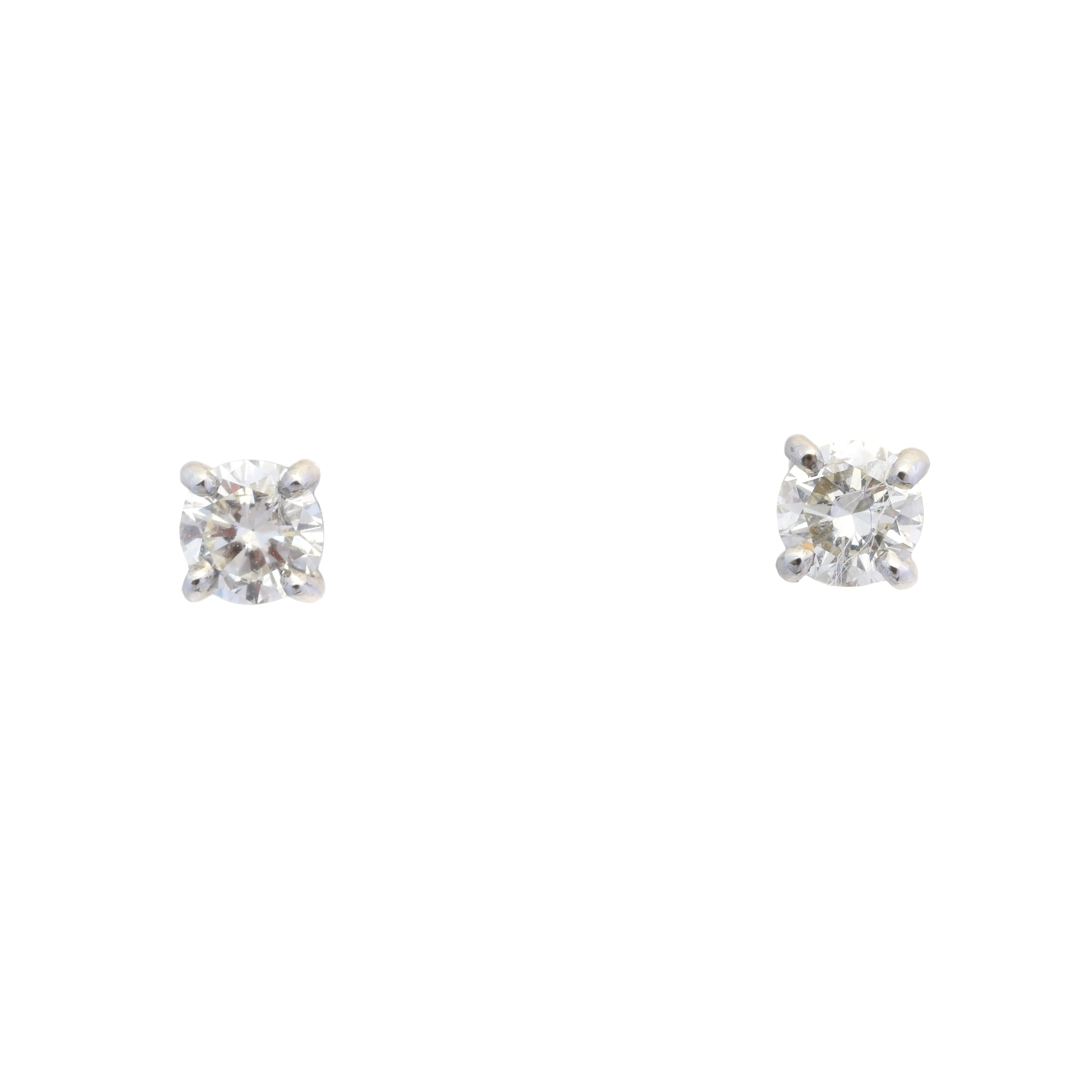 A pair of 18ct gold brilliant cut diamond stud earrings, estimated total diamond weight 0.80ct, estimated colour I-J, estimated clarity P1-P2, hallmarks for Birmingham, gross weight 1.7g.