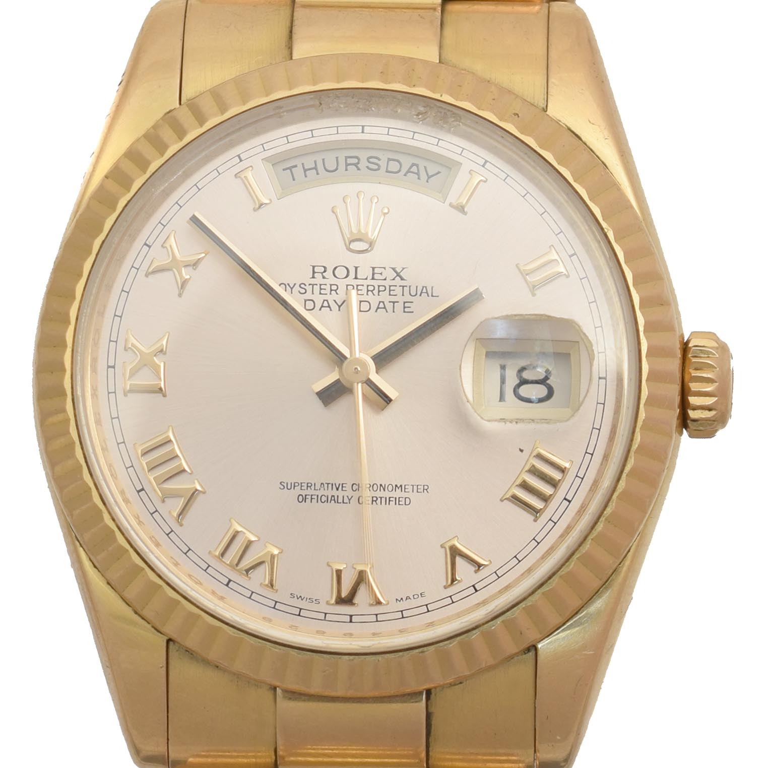 A gents 18ct gold Rolex Oyster Perpetual Day-Date wristwatch, circa 2006-7, the circular signed dial with Roman numeral hour markers, date aperture to 3 and day aperture to 12, with fluted bezel and president bracelet, model no. 118235, Z349629, Swiss assay marks, case diameter 36mm, with single spare link and papers. Sold for £8,540