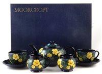 Lot 83 - Moorcroft boxed tea service in buttercup pattern